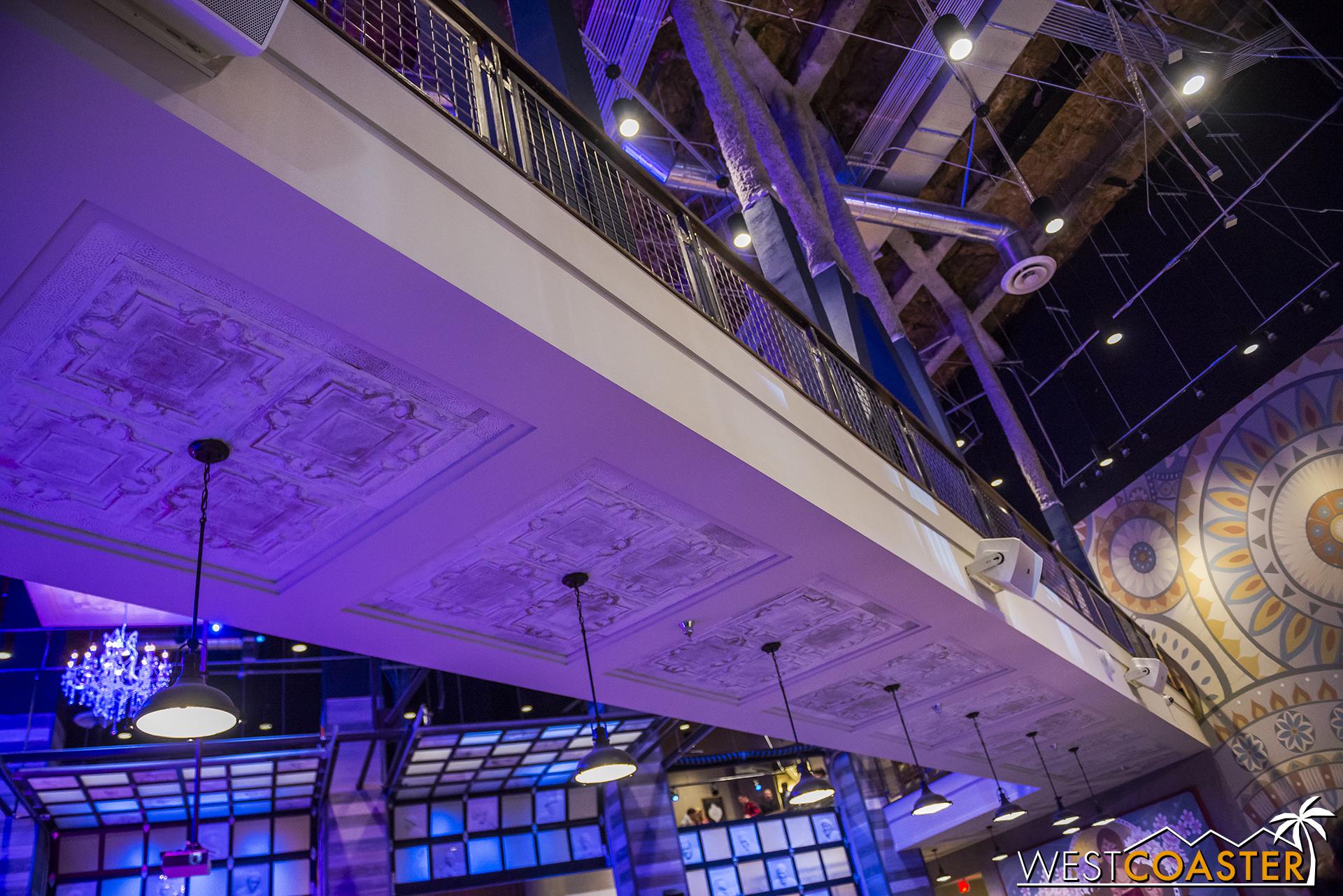 The main restaurant and bar area. Pendant lights hang under a catwalk.