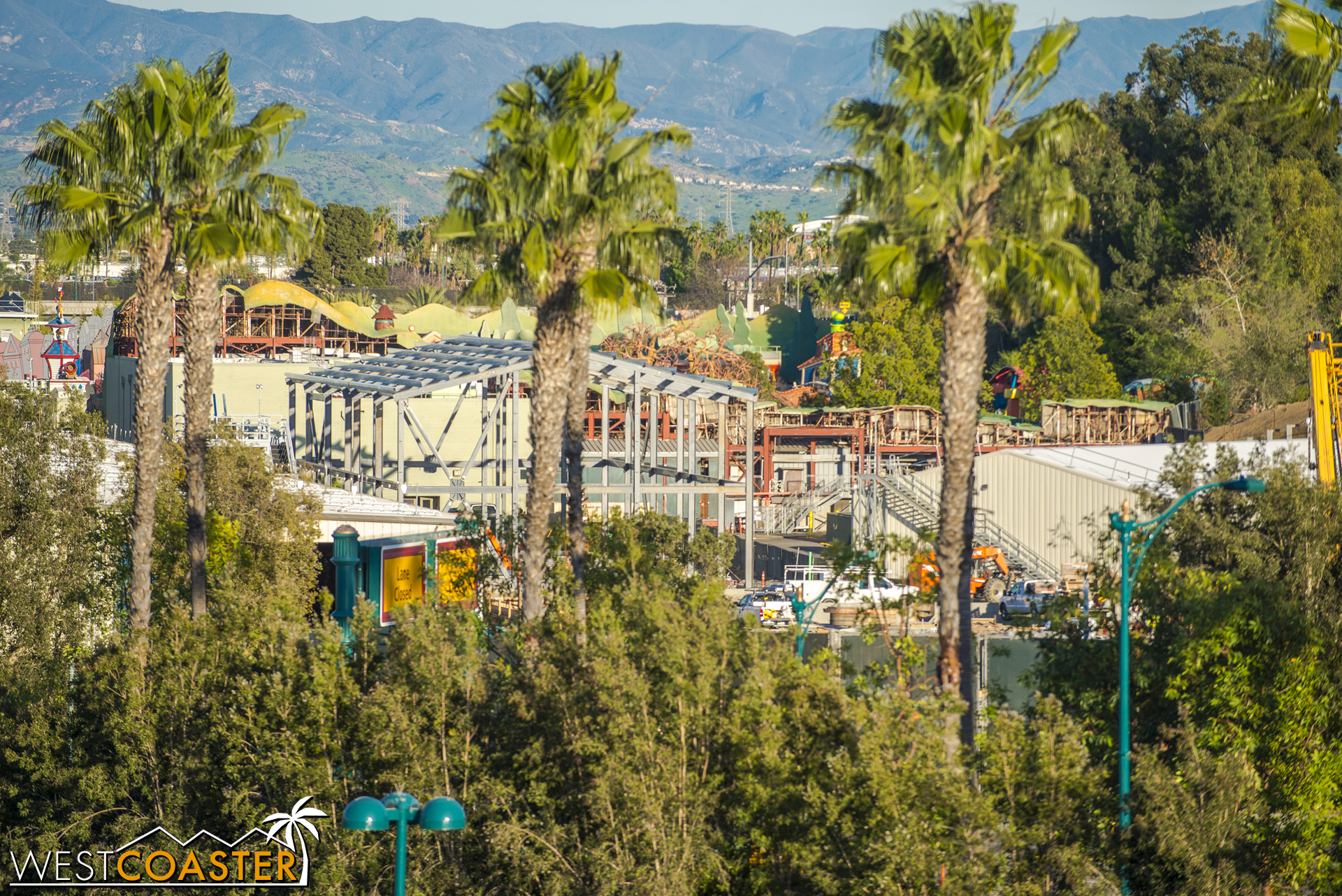 In the back of the site, near Mickey's Toontown, that giant shed building looks nearly fully framed.