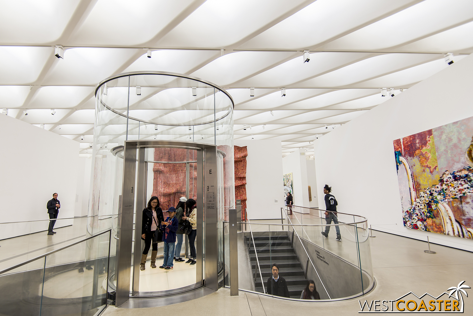 The glass escalator and stair meet at the third floor.