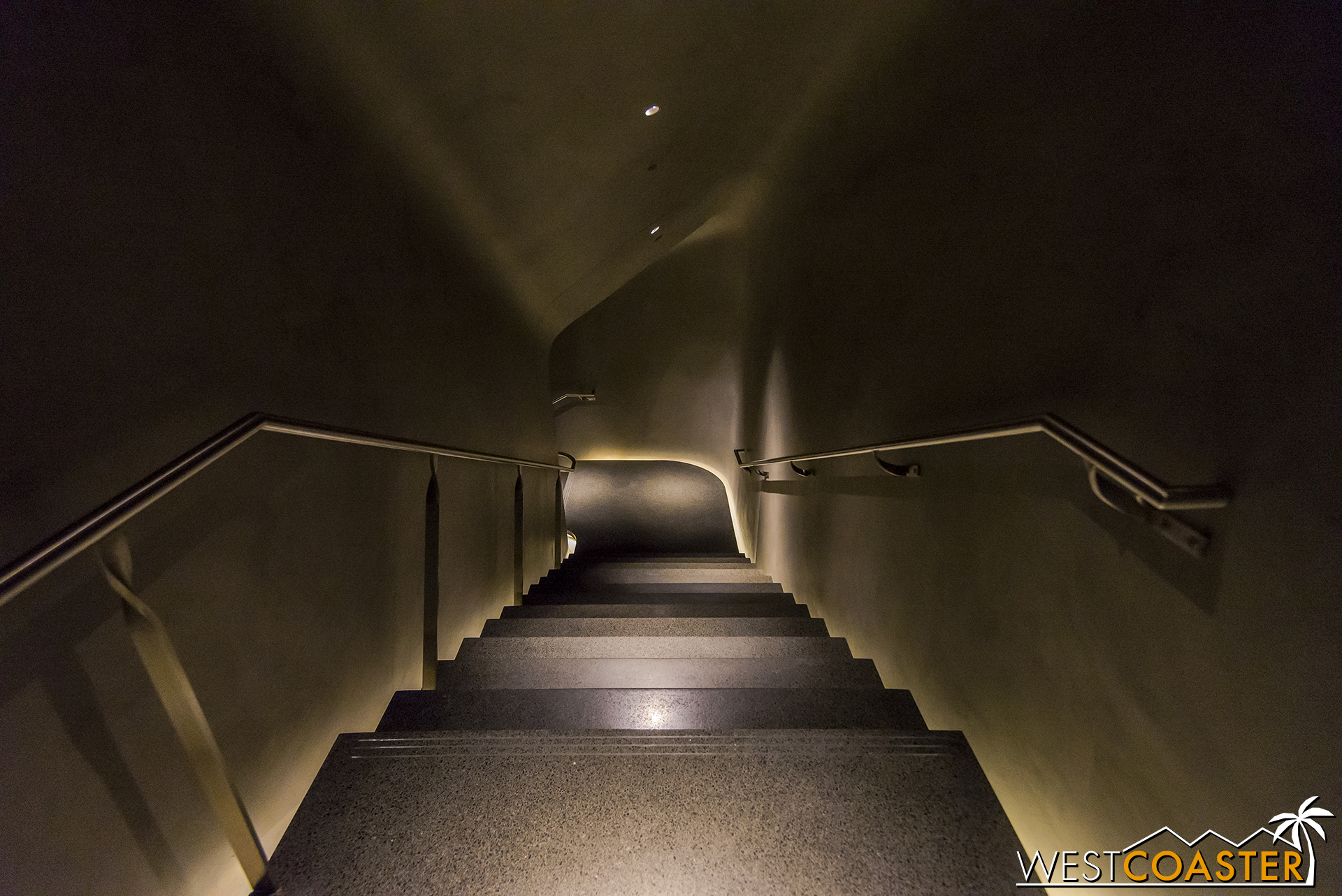 Descending the stairs, which provides a darker experience.