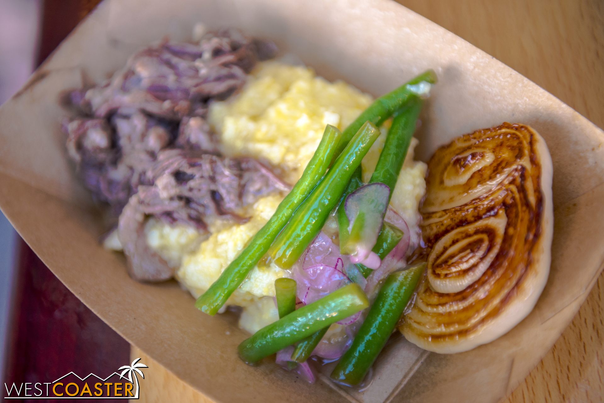 From The Onion Lair:  Braised Wagyu Beef on Creamy Polenta  with Haricot Vert-Red Onion Salad and Roasted Cipollini Onion featuring Melissa's® Produce ($7.75)