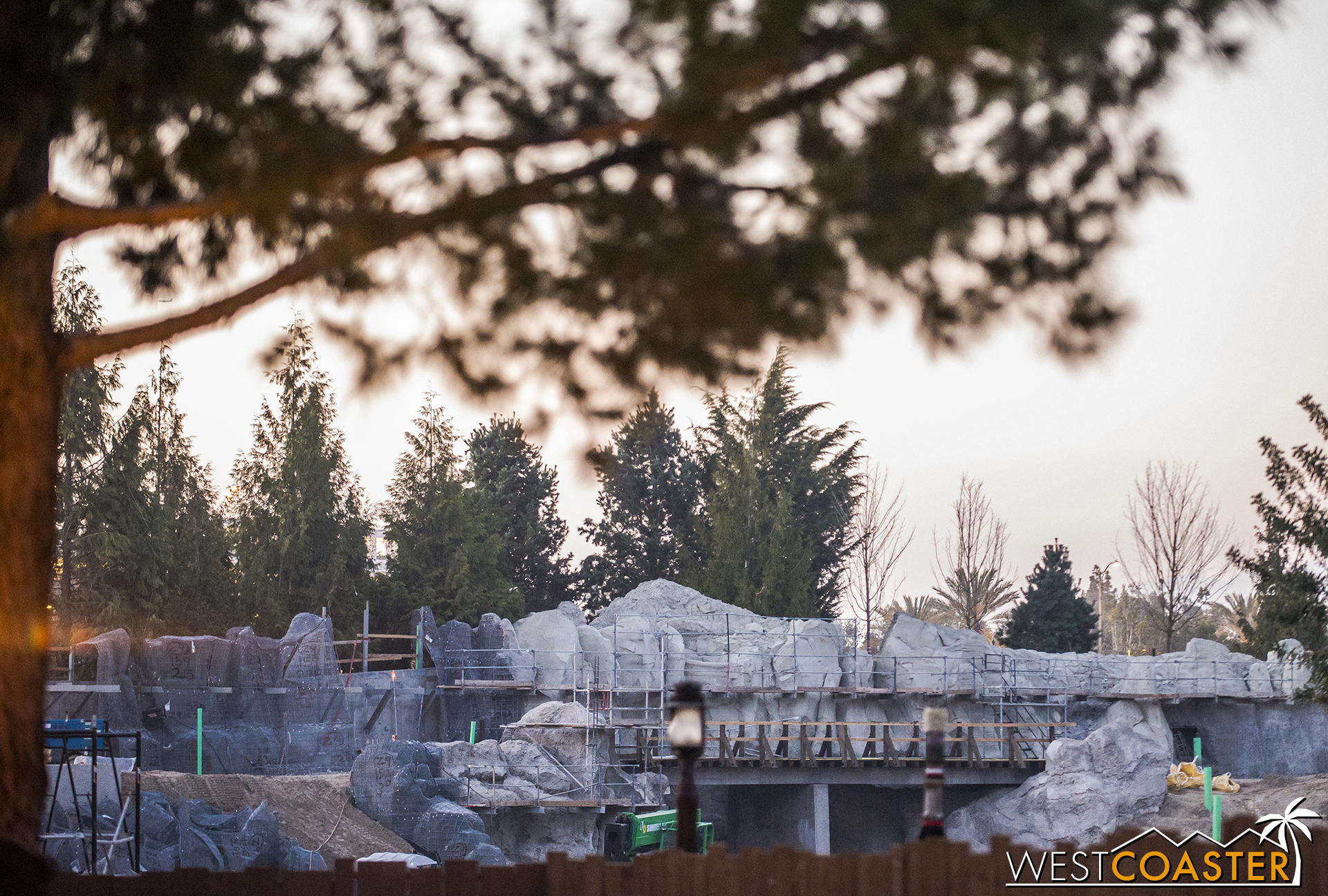 From the Critter Country pathway over toward Hungry Bear, the tops of the rockwork can be seen, plus the route of the redone Disneyland Railroad.