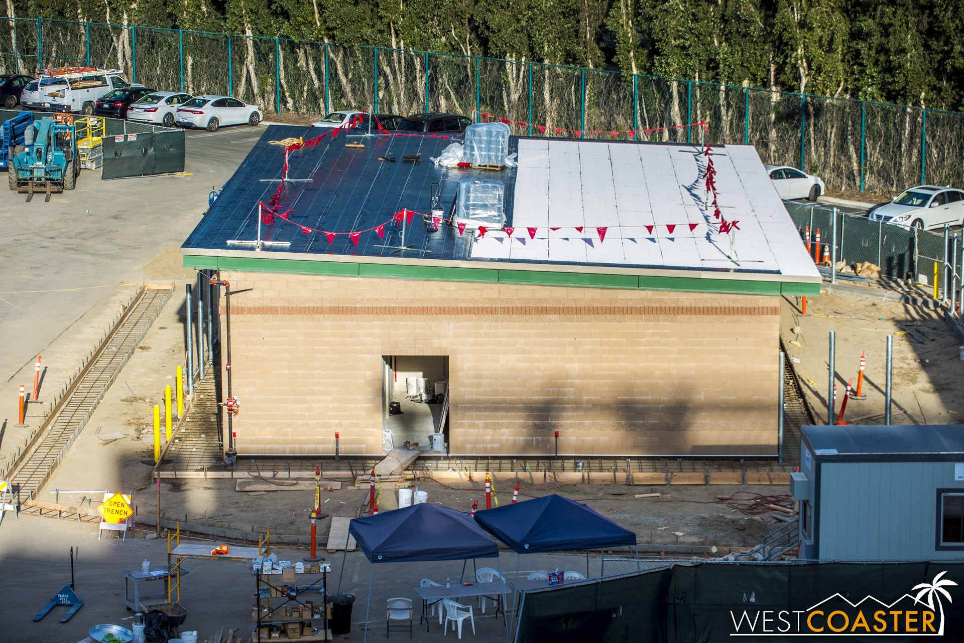 The roof decking is complete on this transportation building, and now they're starting to apply the actual roofing membrane.