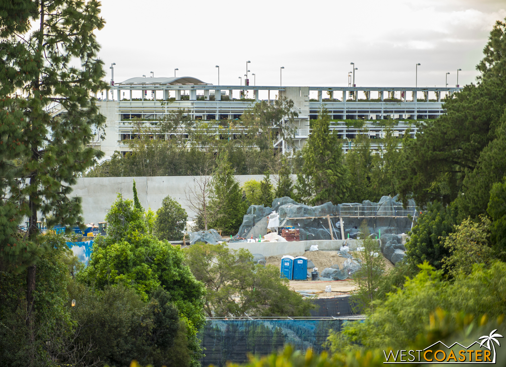 """After all, Disney is pretty good with theming rocks. Also, here's an elevated view, with that big concrete wall in """"Star Wars"""" Land beyond."""