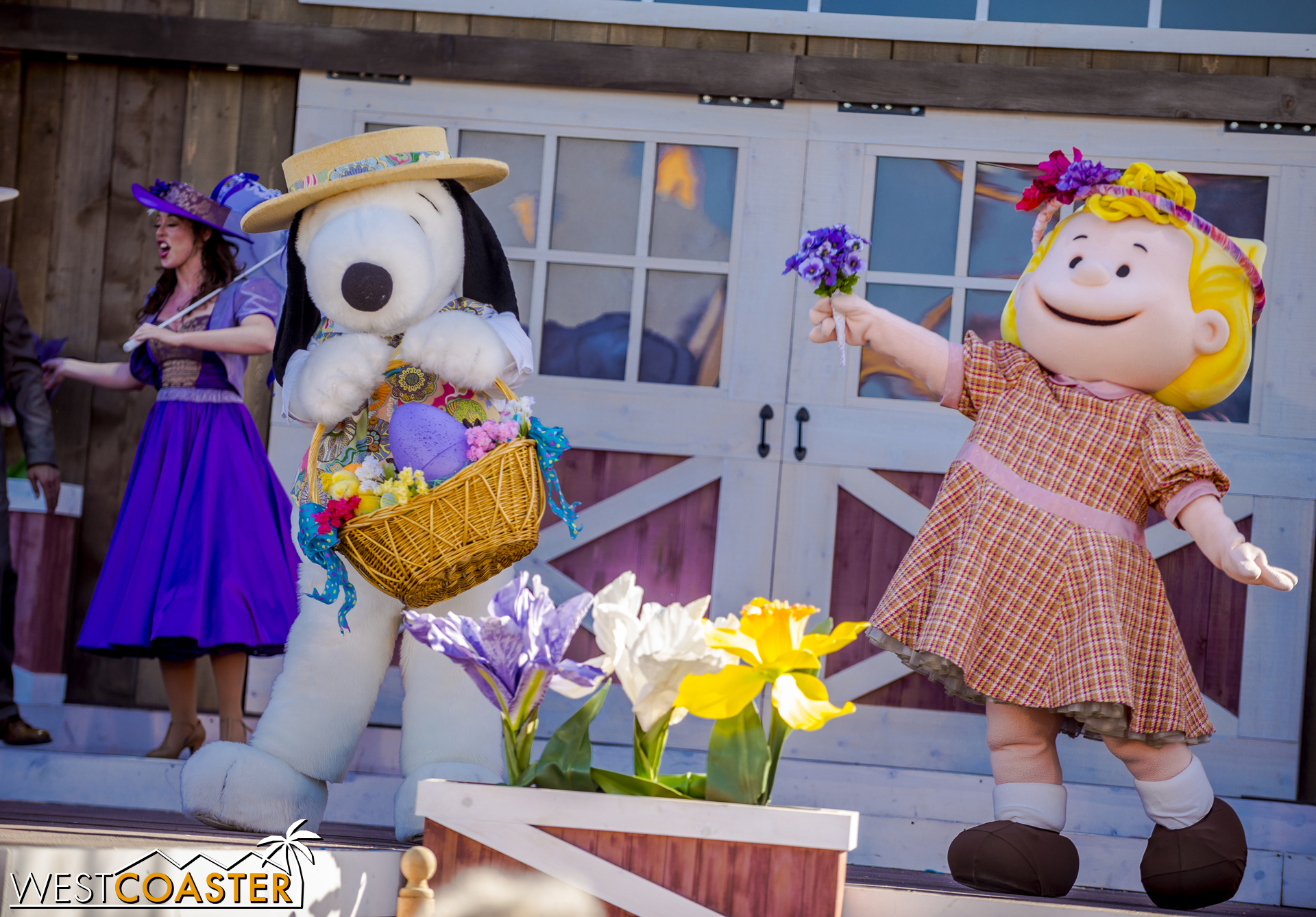 Snoopy plays nice and gives Sally a bouquet.