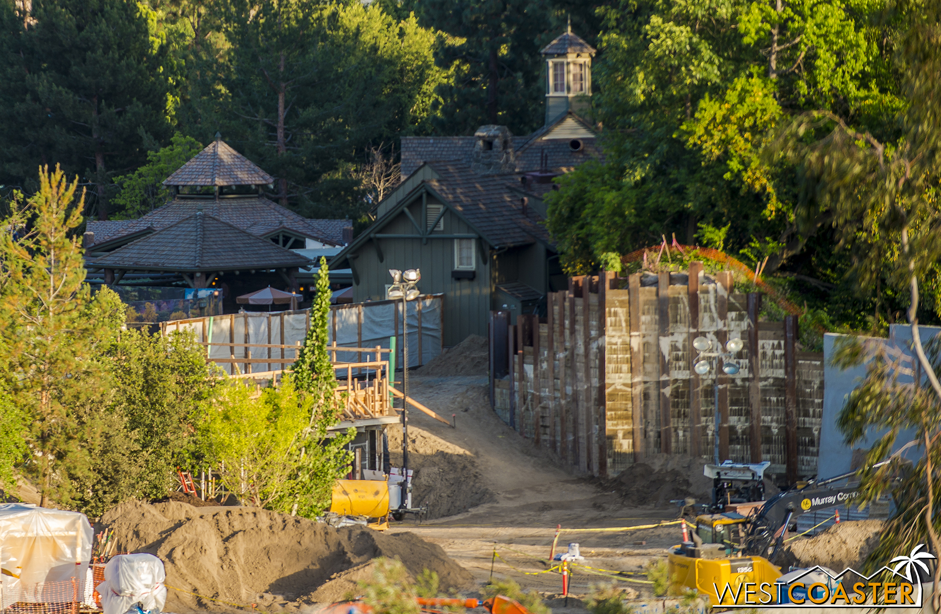 It's the wood framing just in front of and to the left of the green pipe in the middle.  And under that is the dirt that will ultimately become the pathway coming from along the bank of the Rivers of America and just beside the Hungry Bear eating area.