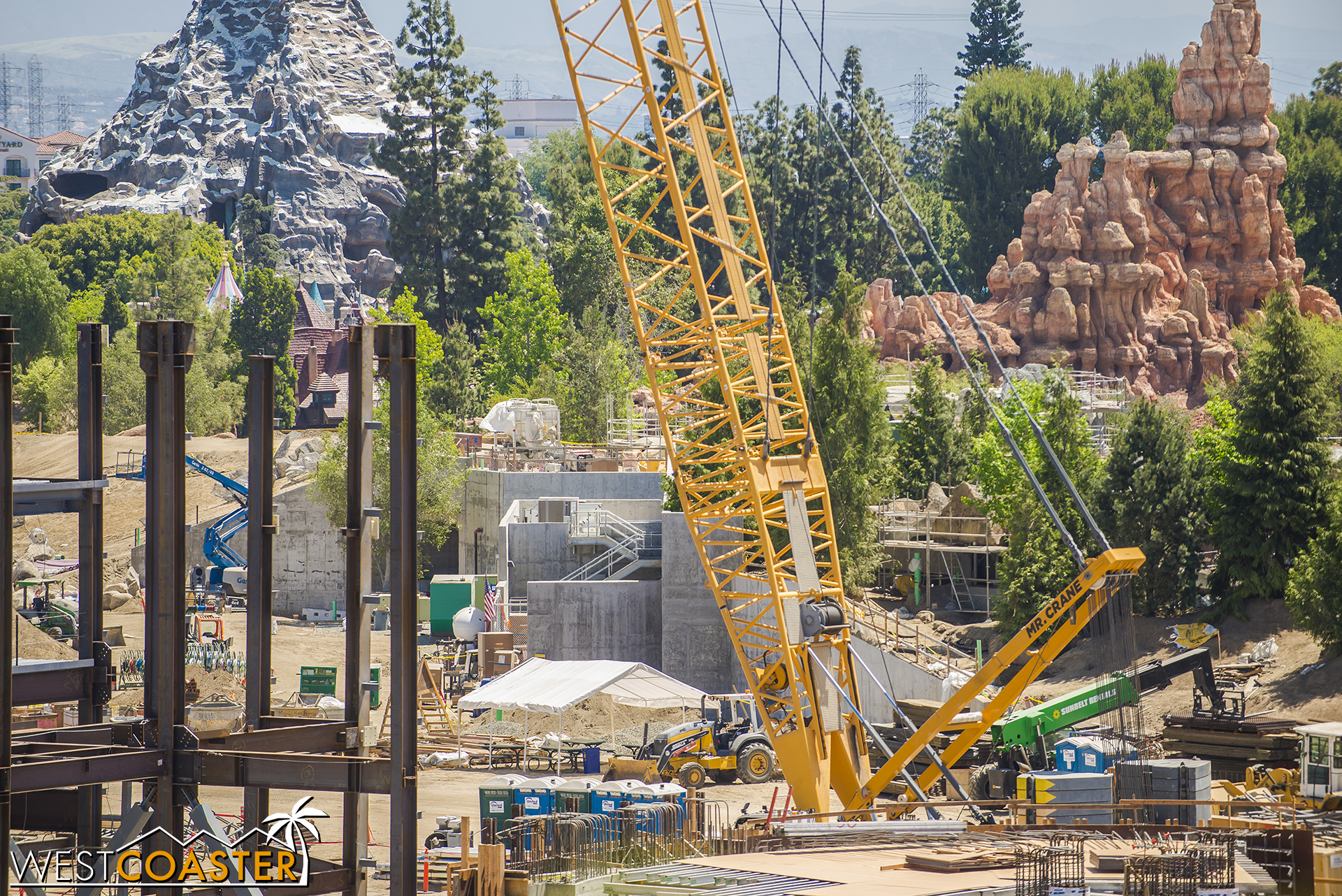"""And they're becoming more and more blocked, but those concrete structures near the main entrance into """"Star Wars"""" Land are continuing to go up and start getting masked behind rockwork."""