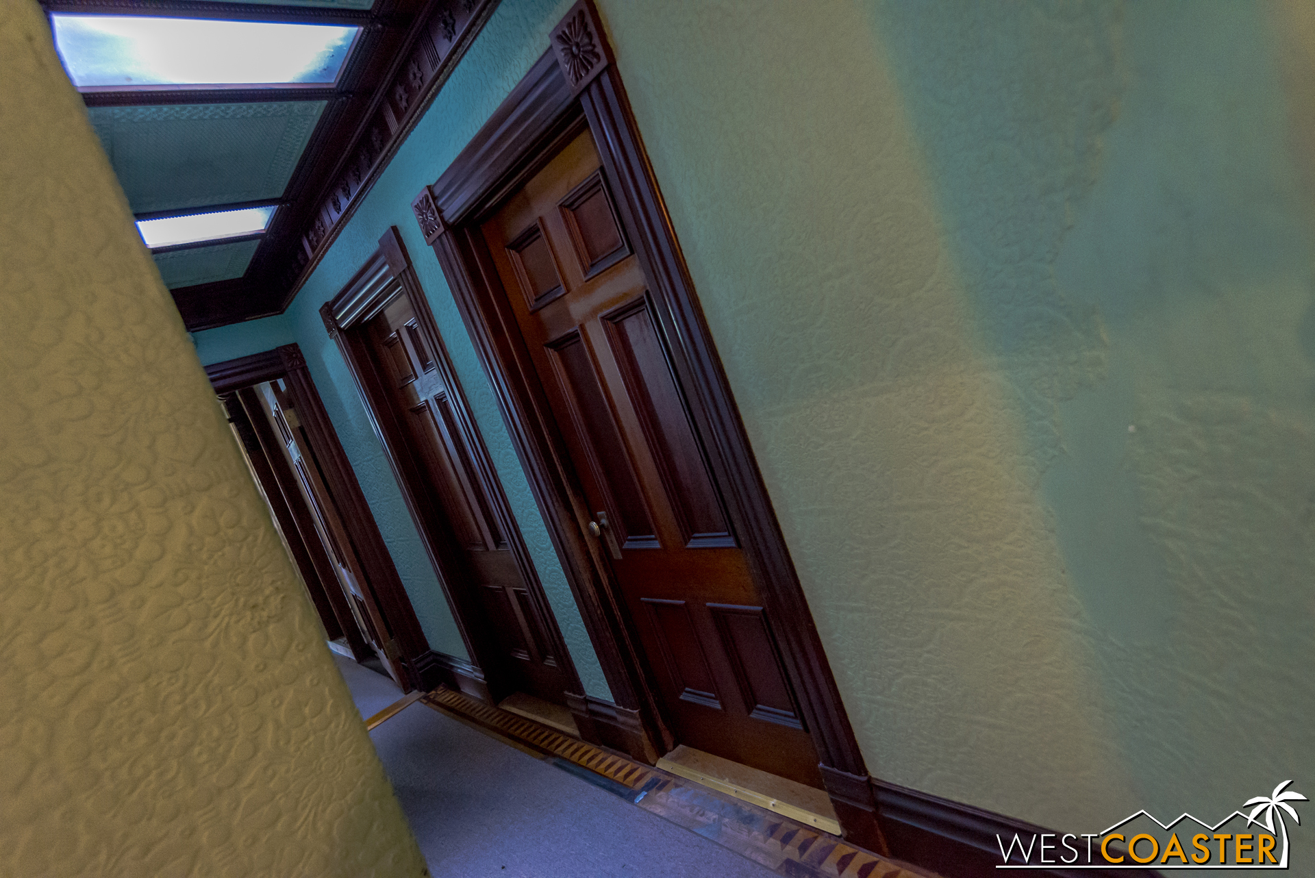This hallway may call to mind the hallway near the beginning of the Haunted Mansion. Disney Imagineers took inspiration from this house.