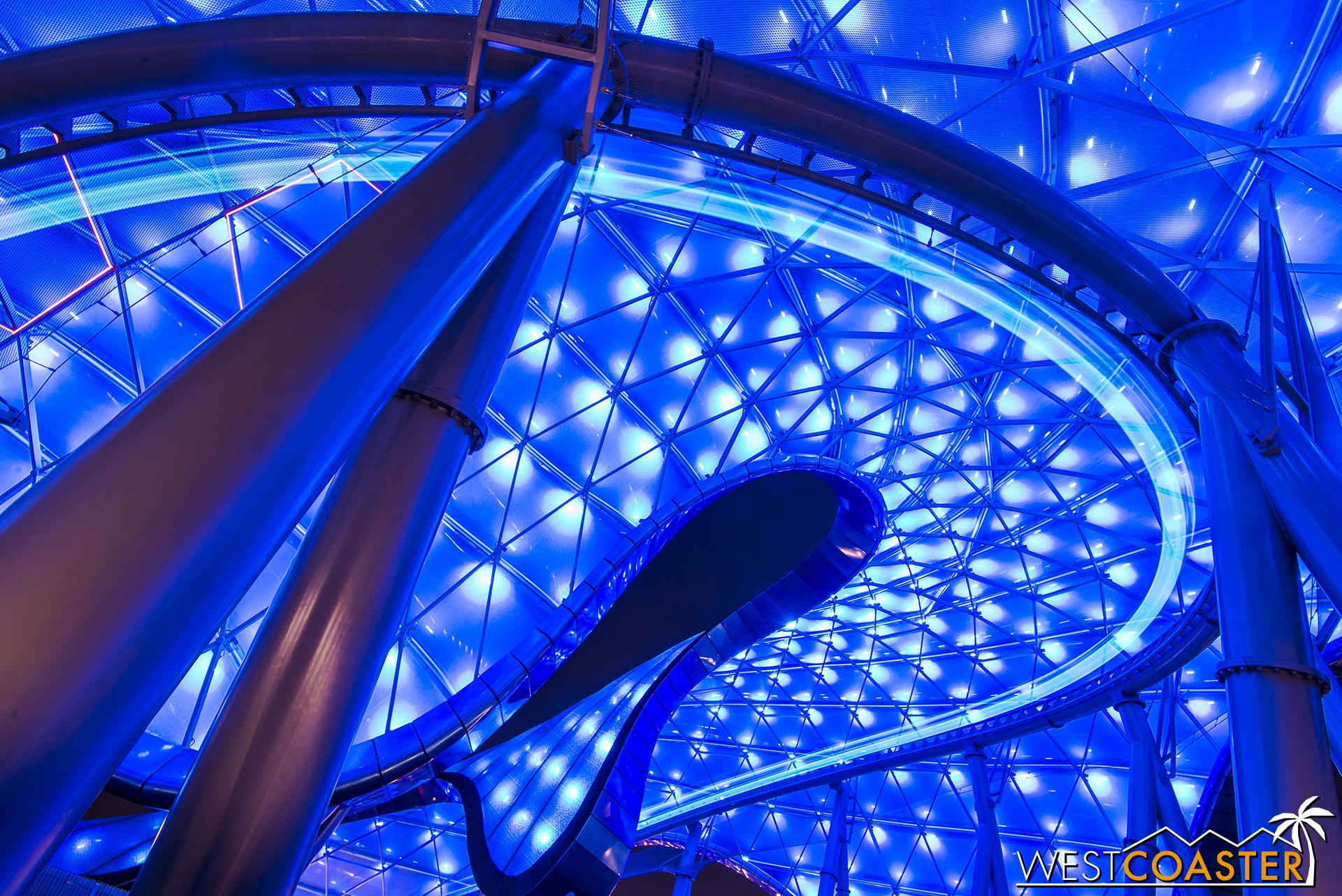 A lightcycle streaks around a turn in Tomorrowland.