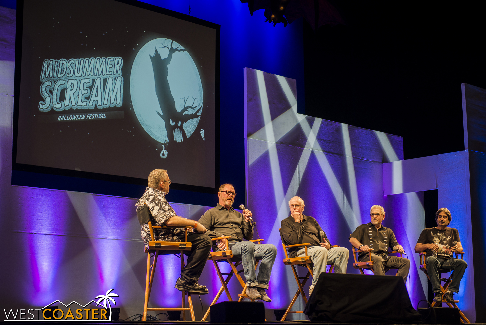 Rick West on the left, with the Imagineers in the middle, and Mark Silverman on the right.