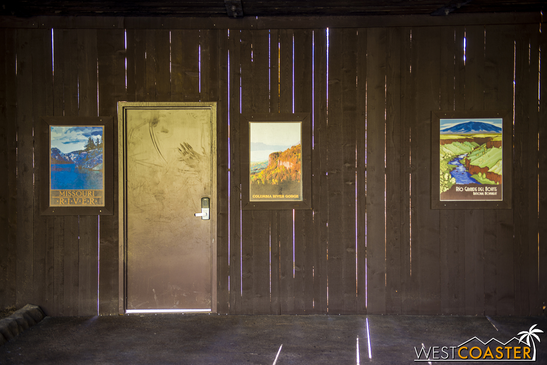The work walls showcase the new waterfalls that are part of the Disneyland Railroad passage along the Rivers of America.