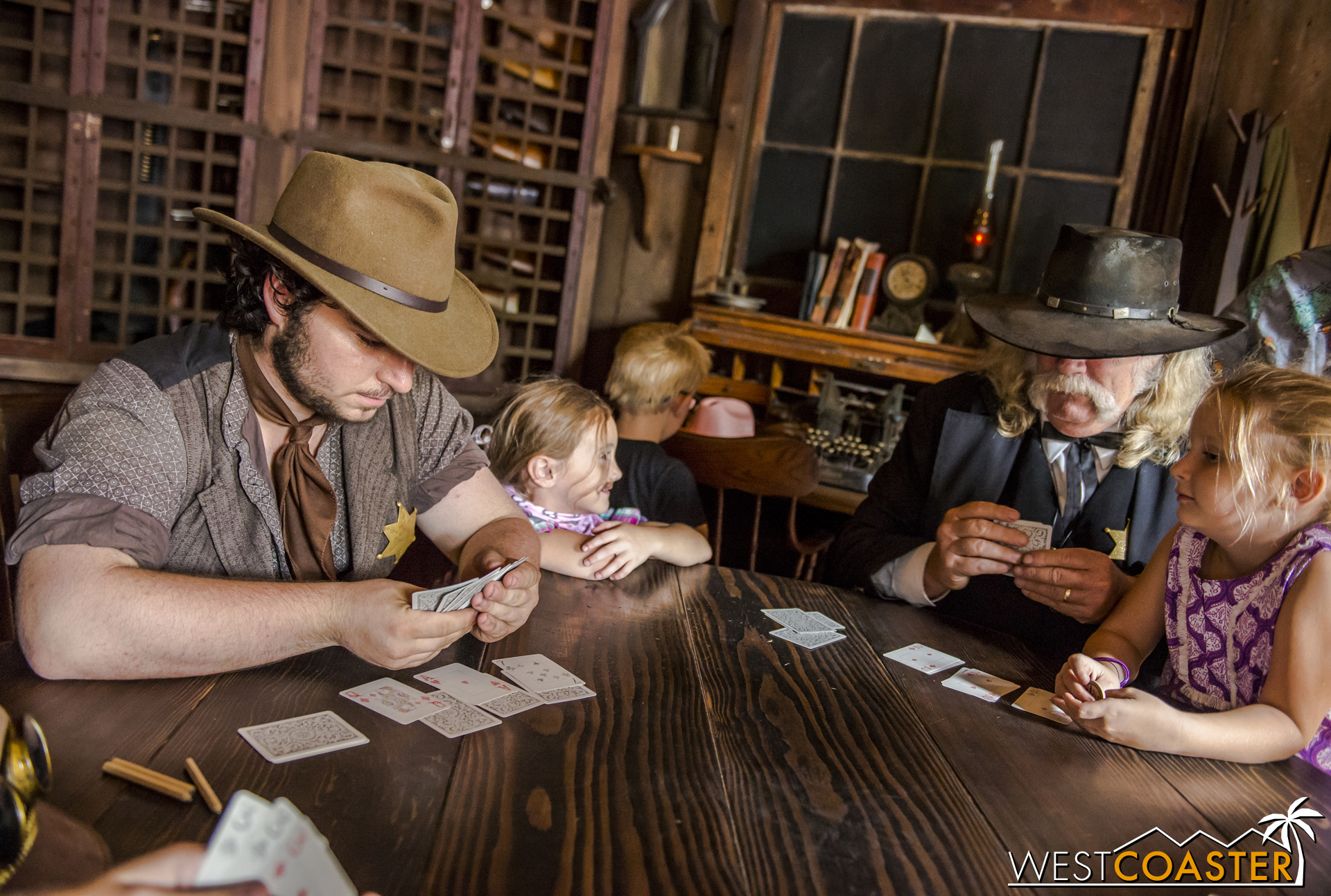 Guests play cards with the Calico sheriff force in Ghost Town.