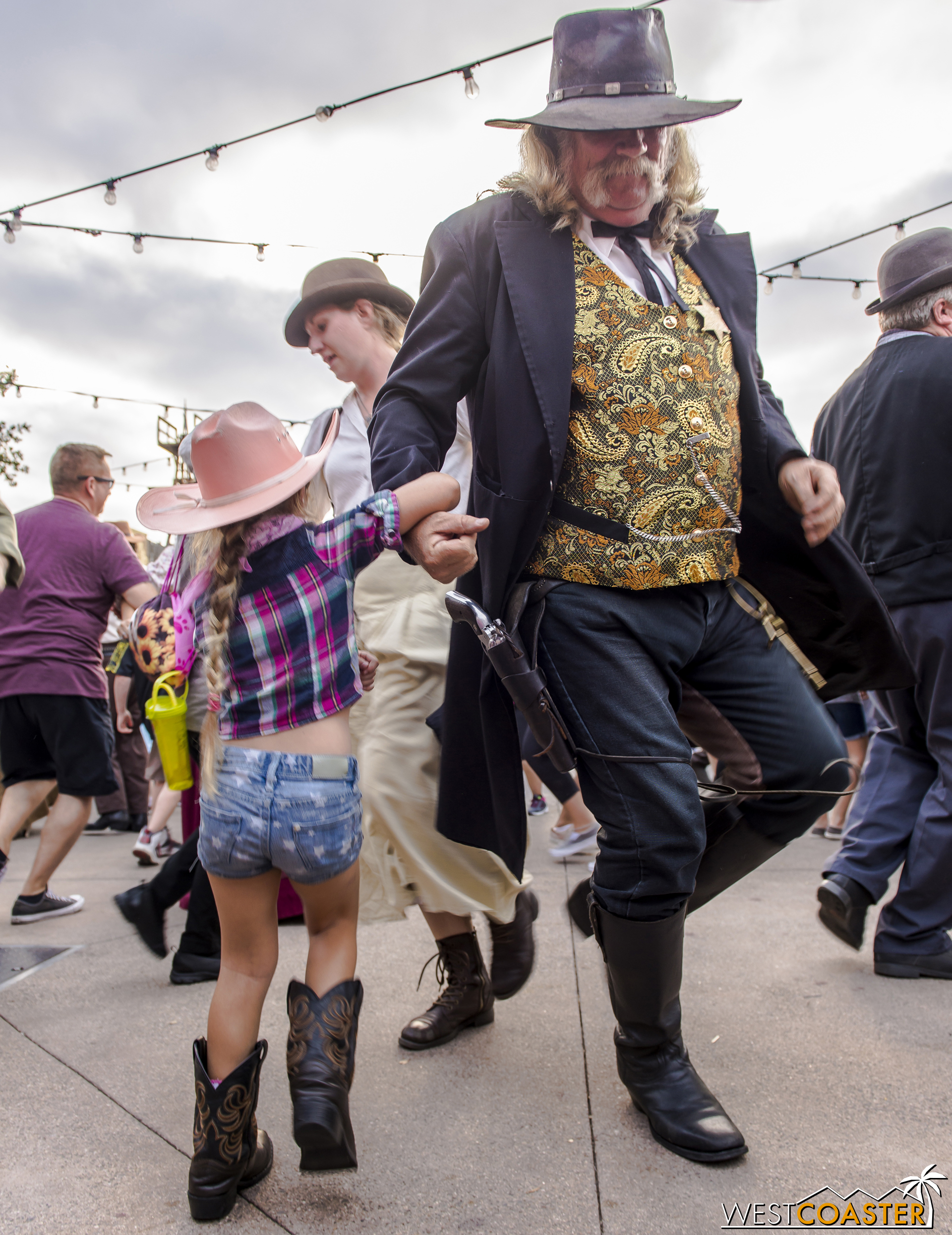 A young guest dances with Sheriff Wheeler at the Calico Founder's Day Hoedown.