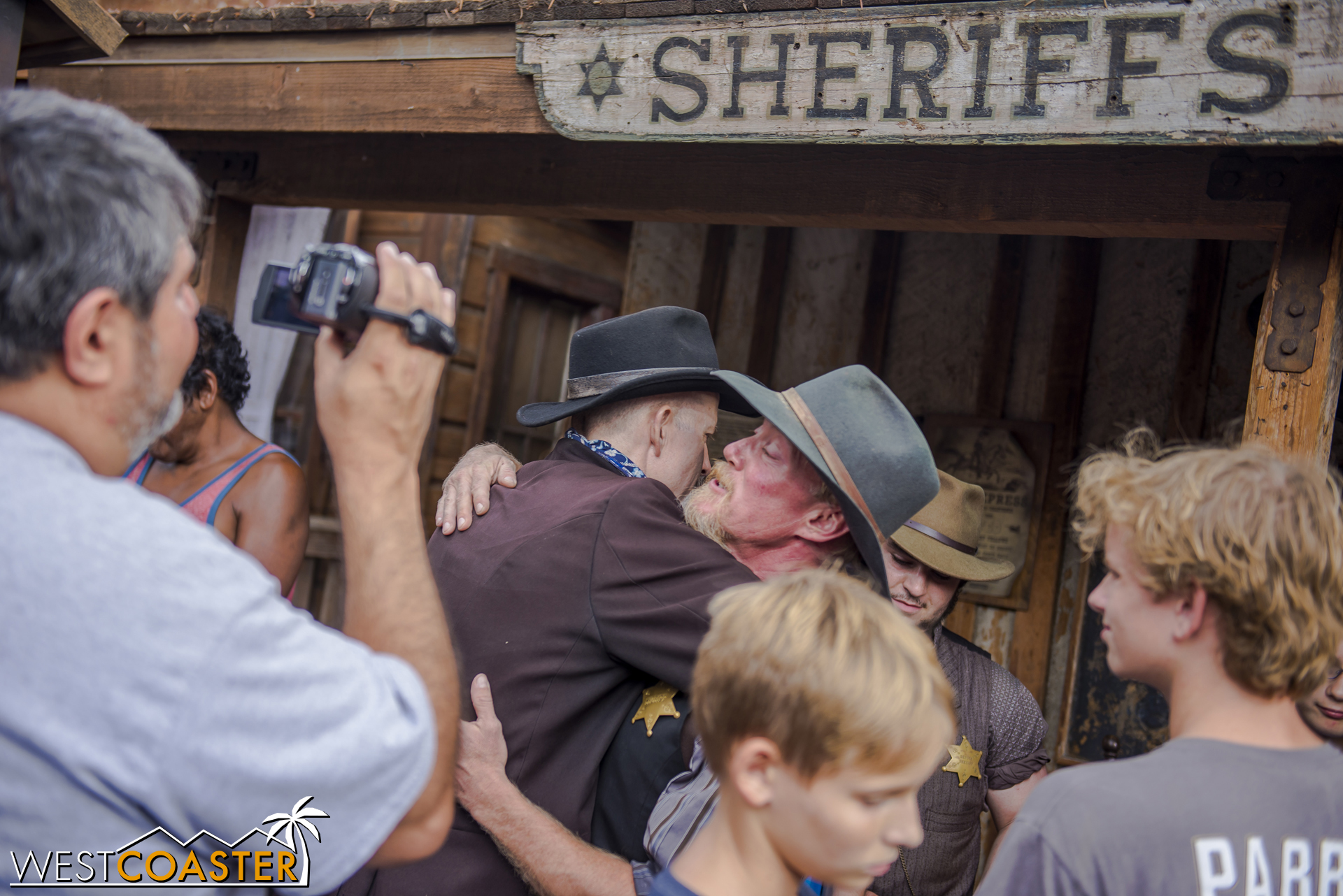 Father and son embrace after the success of the Mayfield scheme. Now they're free, AND they own the town of Calico!