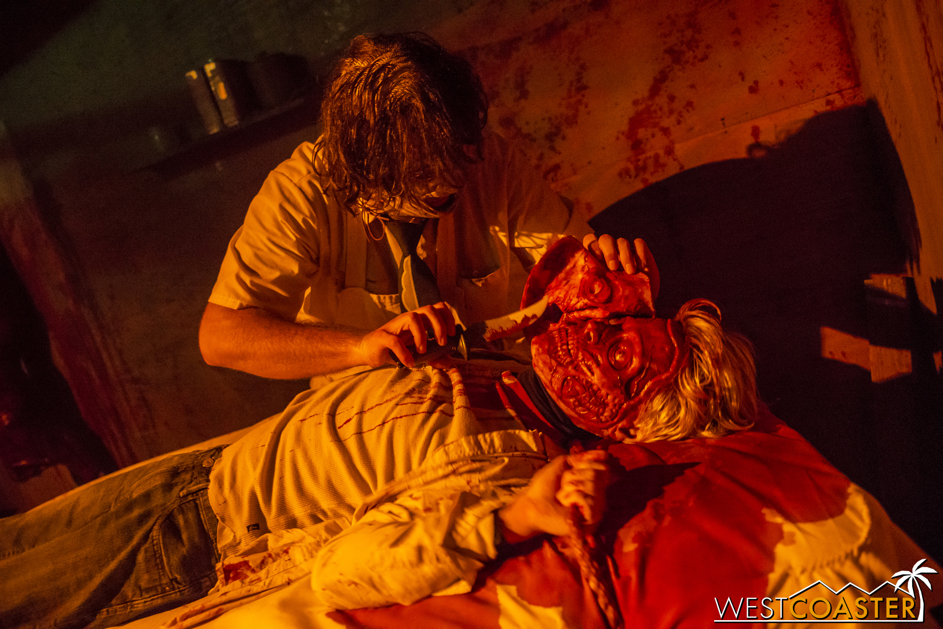 Leatherface performs facial surgery here similar to his role in the Titans of Terror maze. It's still not pretty.