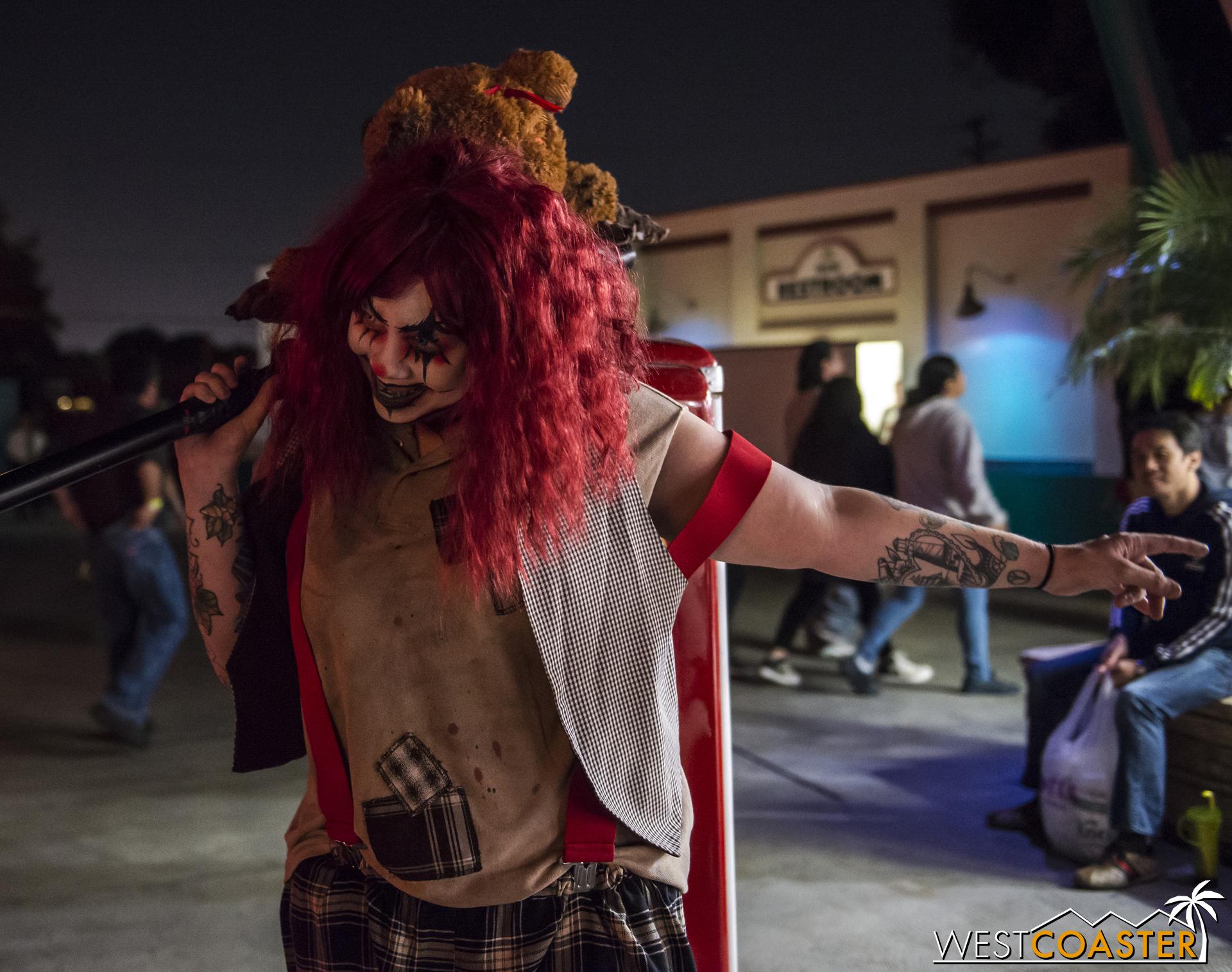I love this clown's stuff animal on a stick.