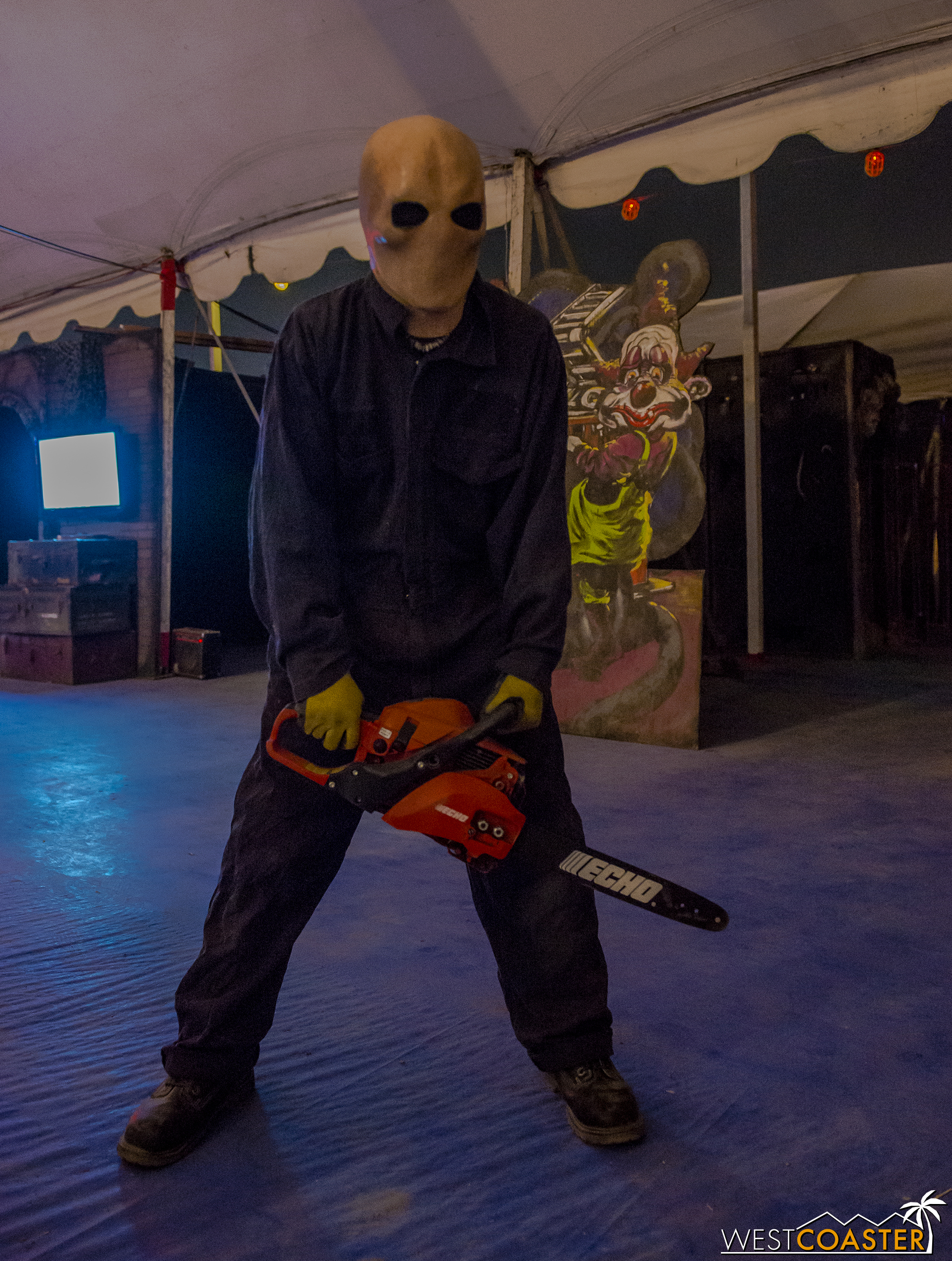 A chainsaw-wielding faceless terror wanders out from DeathWorx, one of the mazes this year.