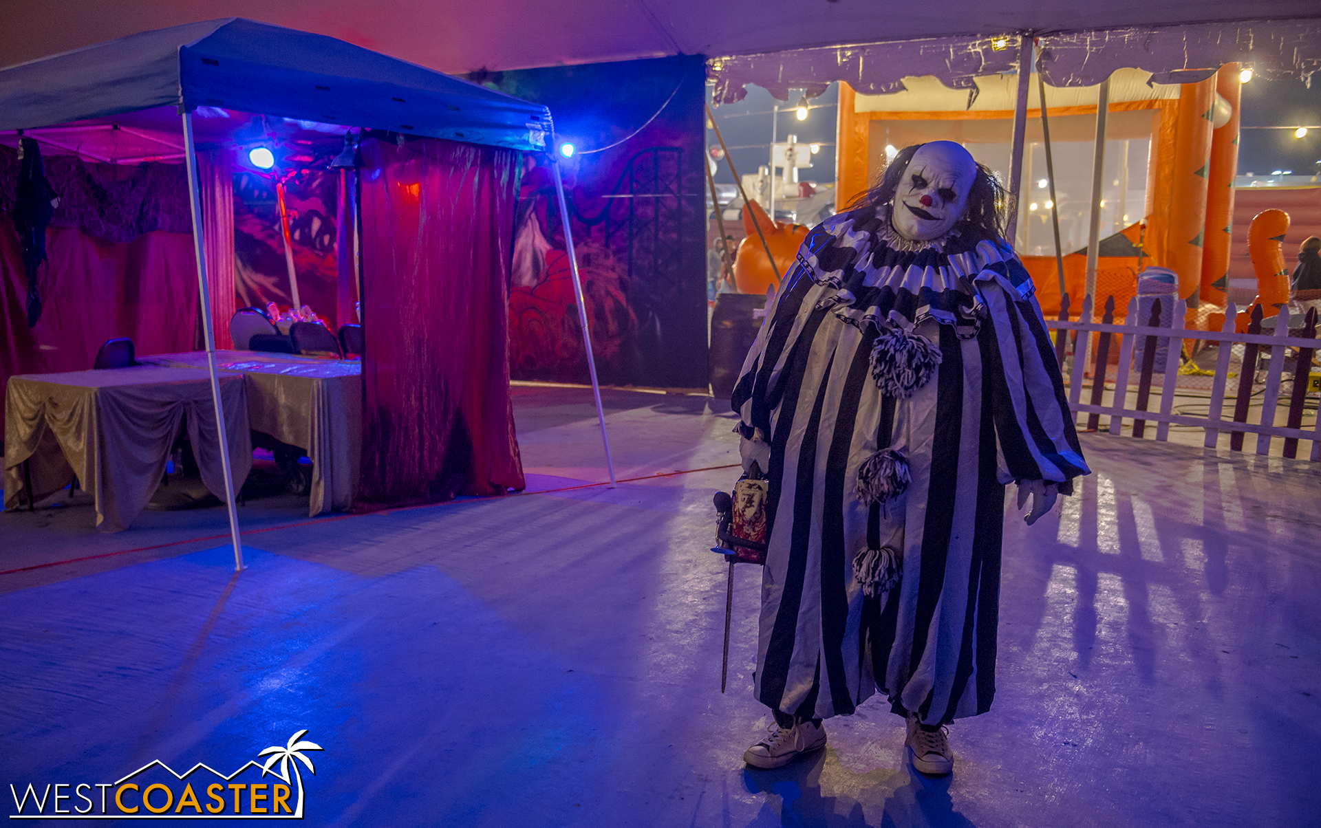 A chainsaw-wielding clown is one of several carnival characters who terrorize.