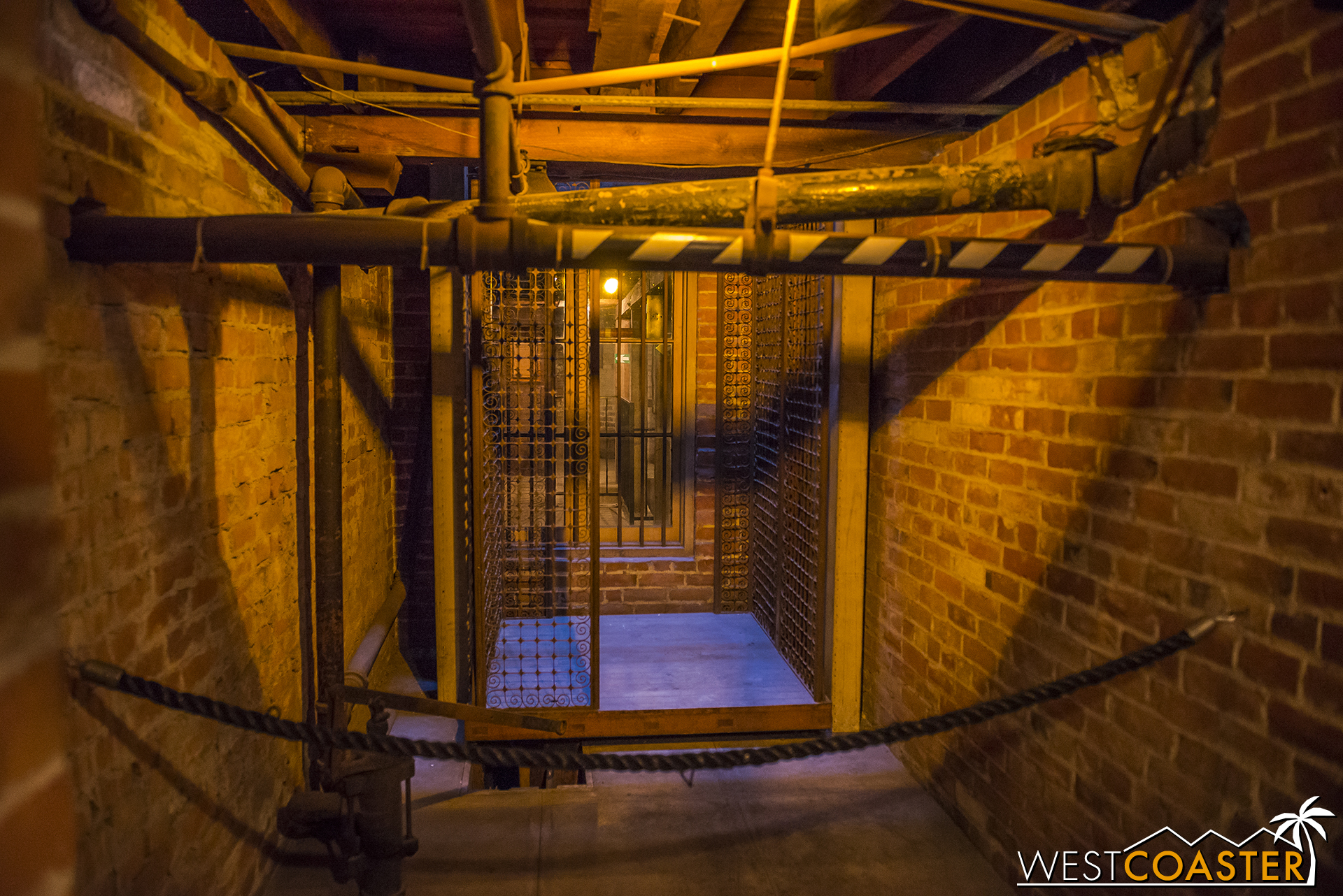 A trip through the basement passes by one of the house's elevators--now no longer in use.