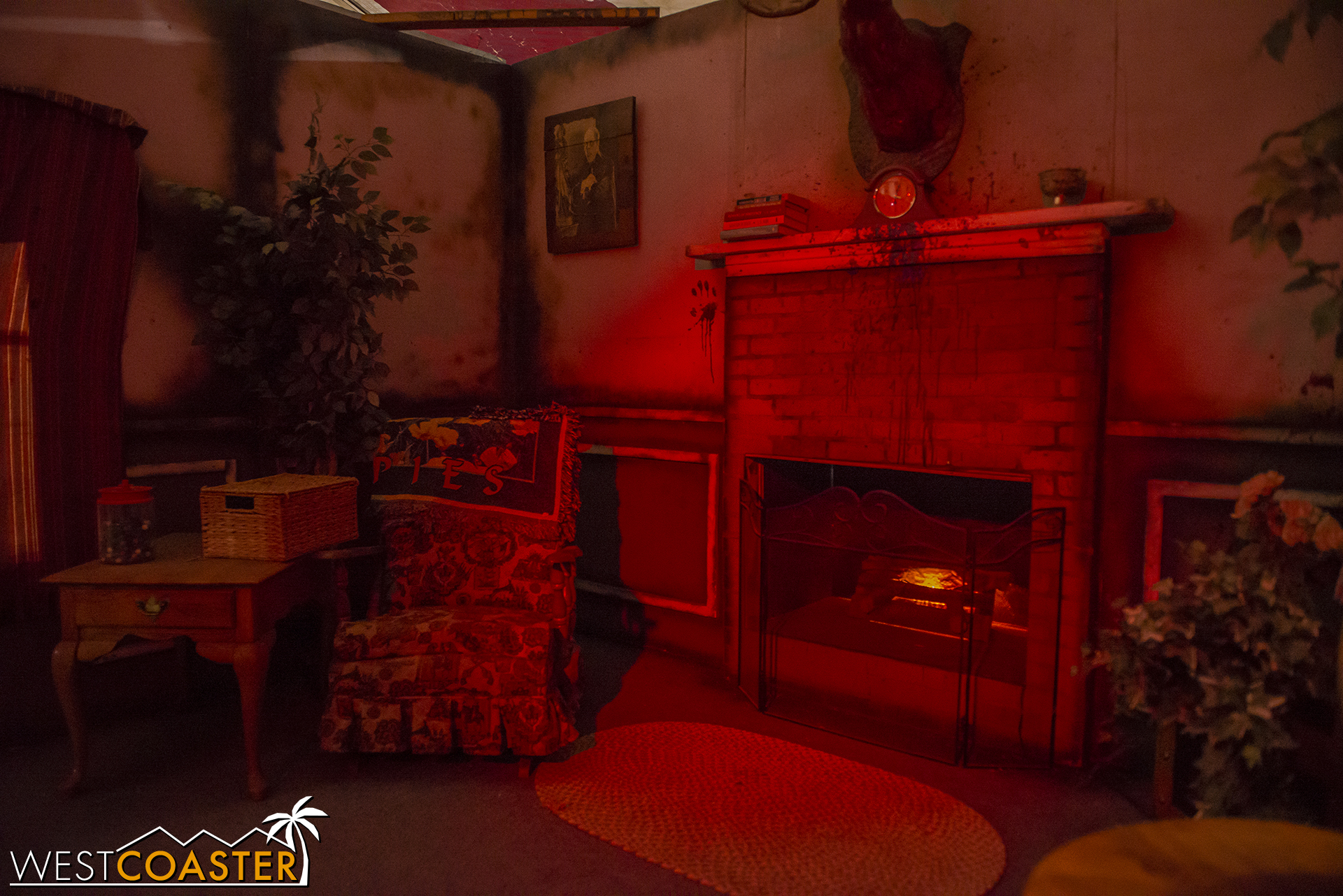 Guests enter the living room for a quick photo before continuing on through the maze.