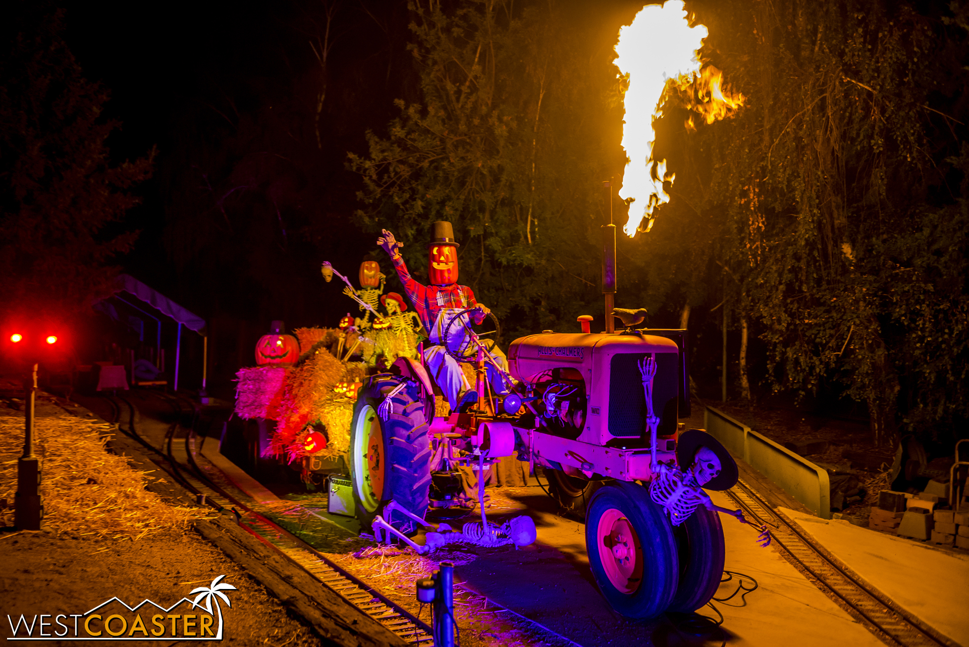The flamethrower of this tractor is rigged to go off when a train passes by.
