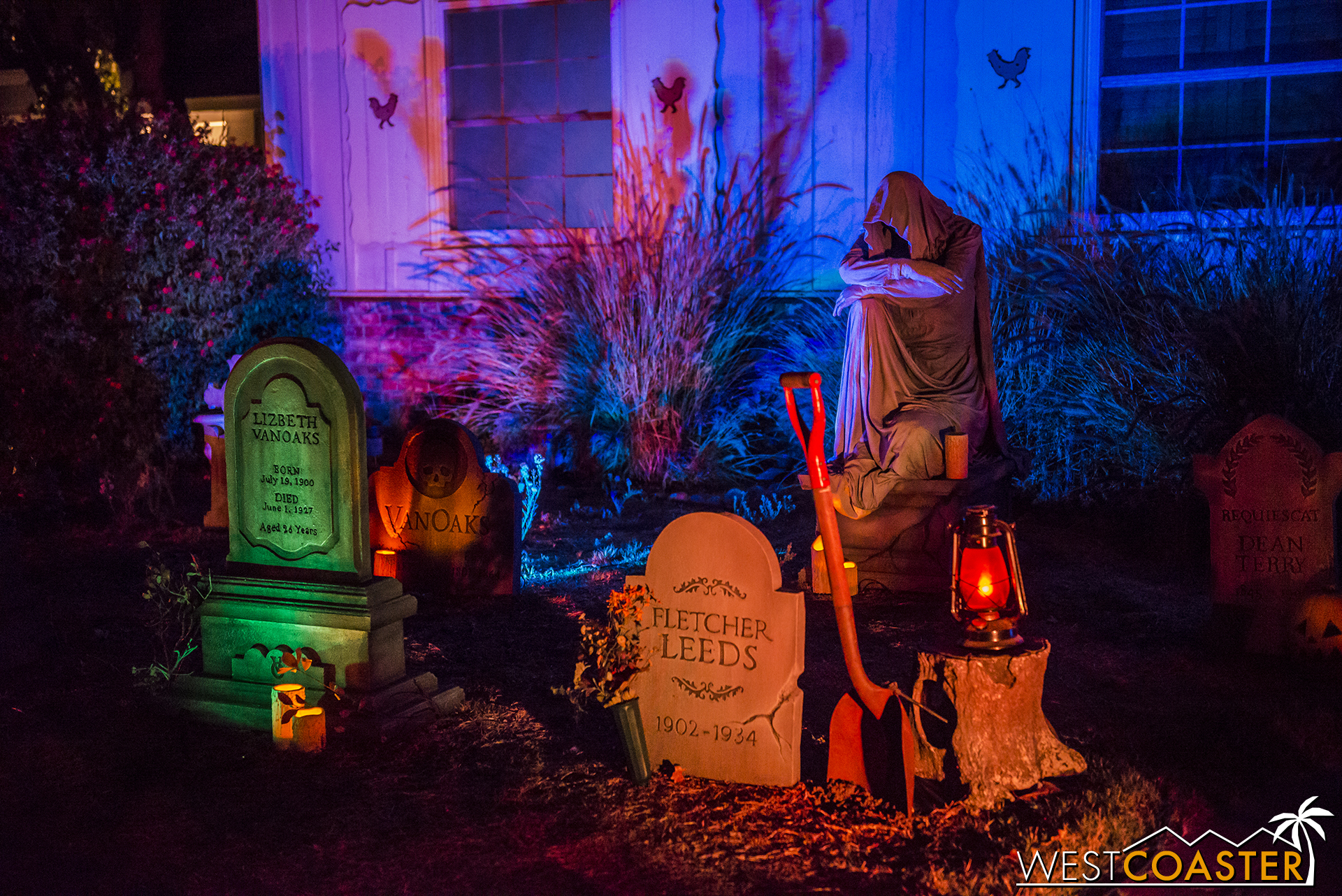 The combination of lighting, props, and a few moving elements gives this front yard cemetery a very cinematic feel.