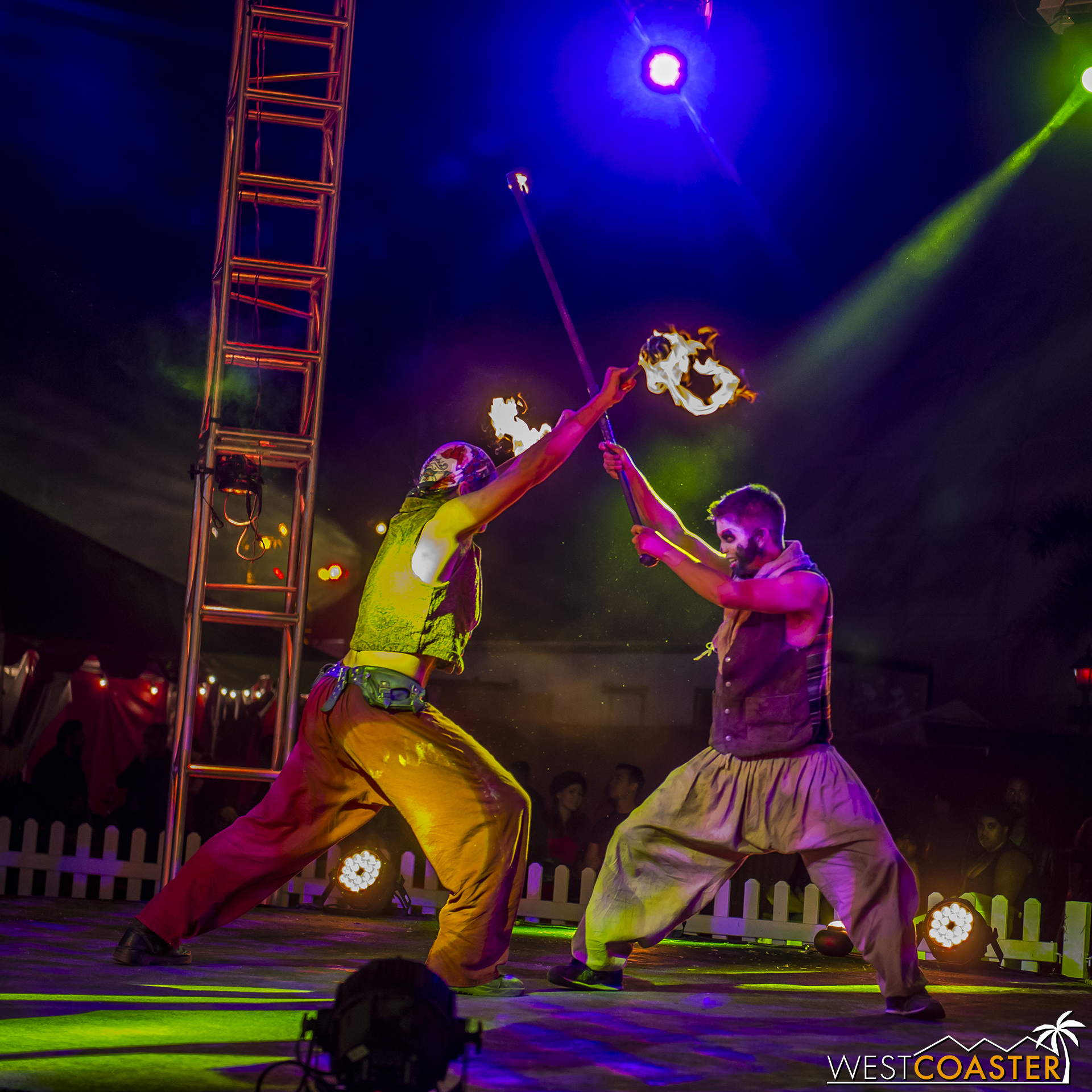 Very talented fire spinners do battle and engage in tricks and stunts to thrill the audience with their fire play.