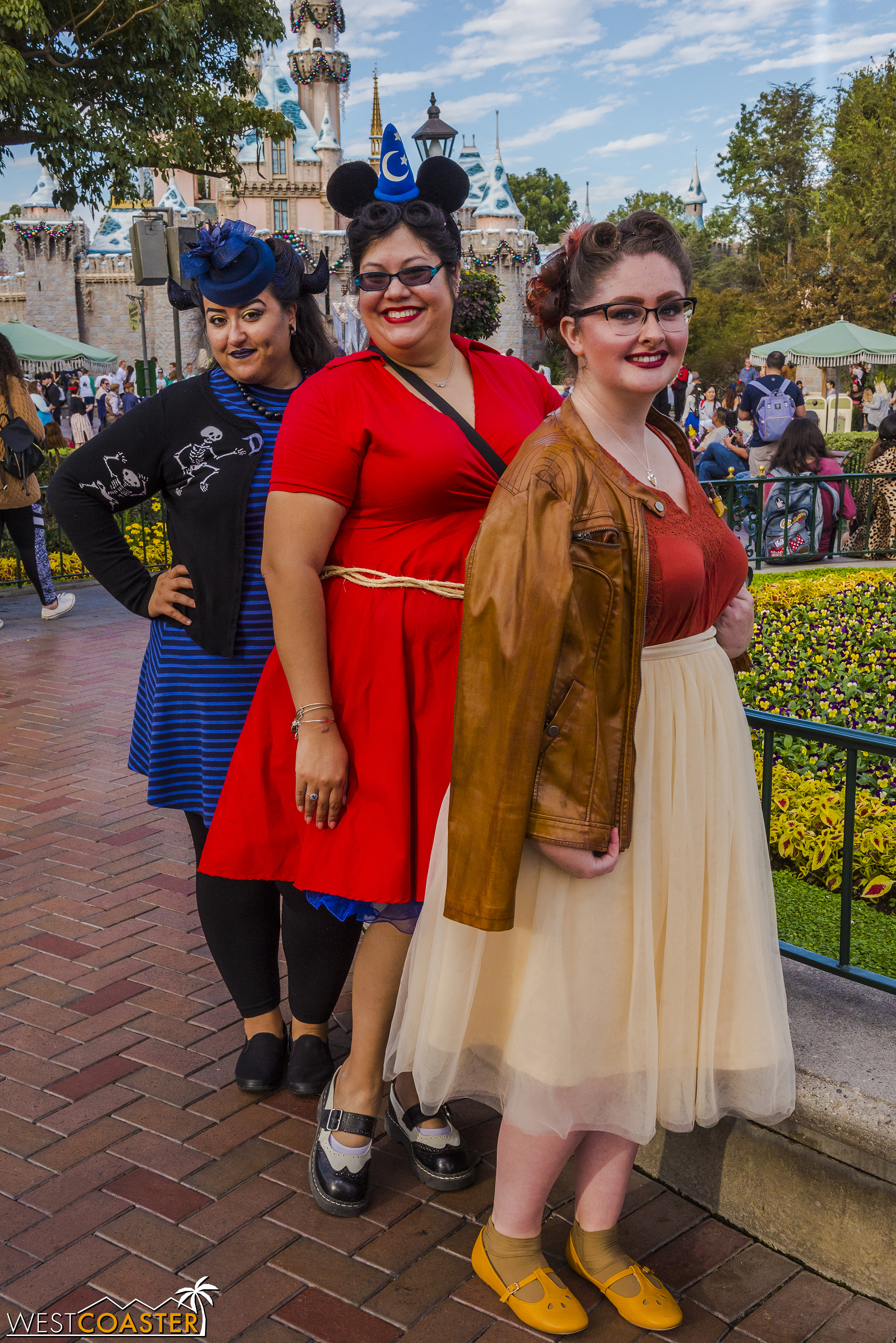Back to front, Chernabog, Sorcerer Mickey, and a broom create a Fantasia trio!