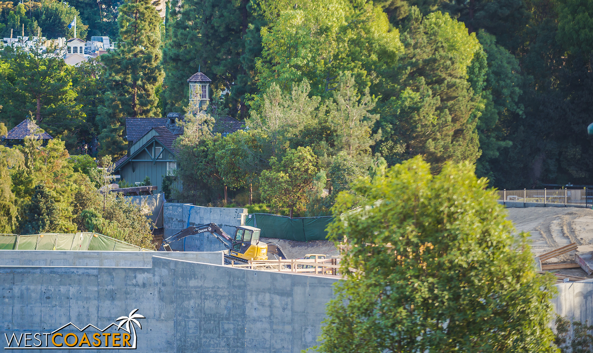 We can see some bit of earthwork at the Critter Country entrance.  Some new concrete forms being laid down.