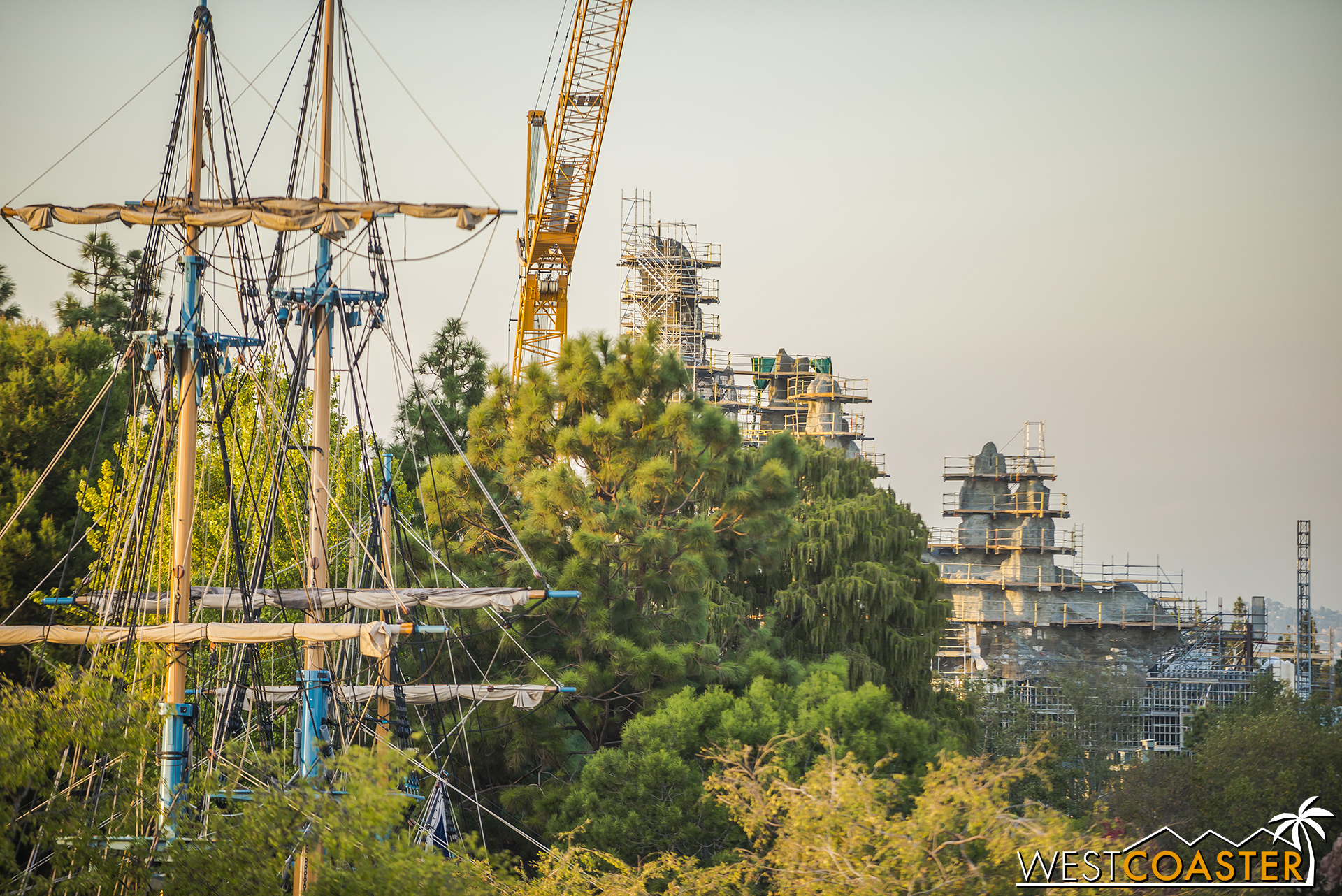 The peaks peek out past the trees of Frontierland.
