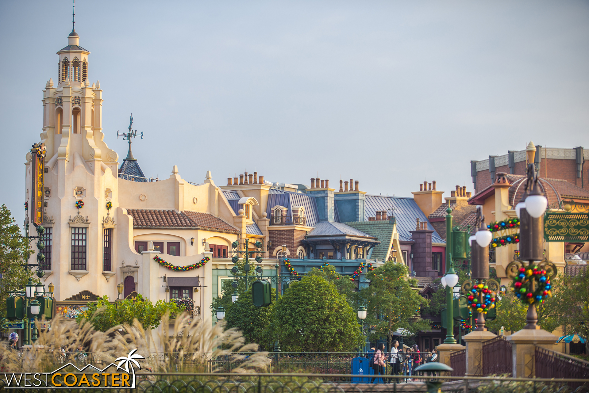 A familiar iconic tower anchors the end of Mickey Avenue, and beside it, the Walt Disney Grand Theatre.