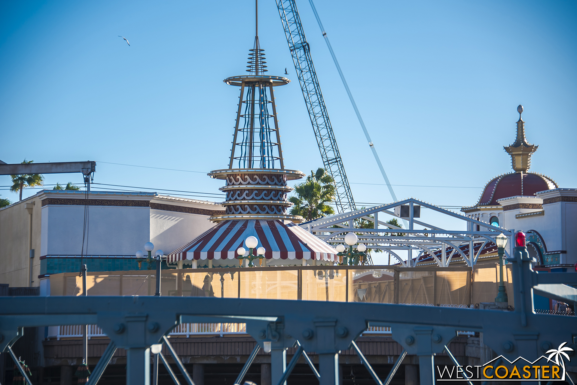 Work walls and screens are up around the stores across from Ariel's Grotto.