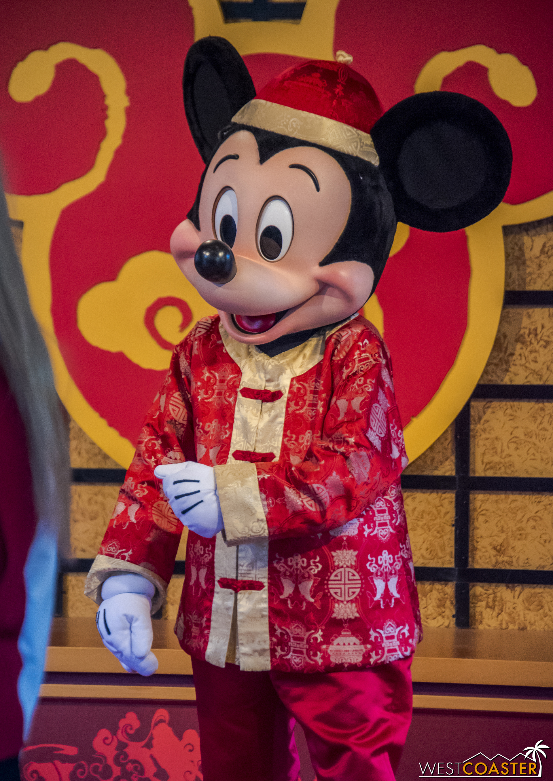 Mickey looks pretty dapper in his traditional Chinese garb.