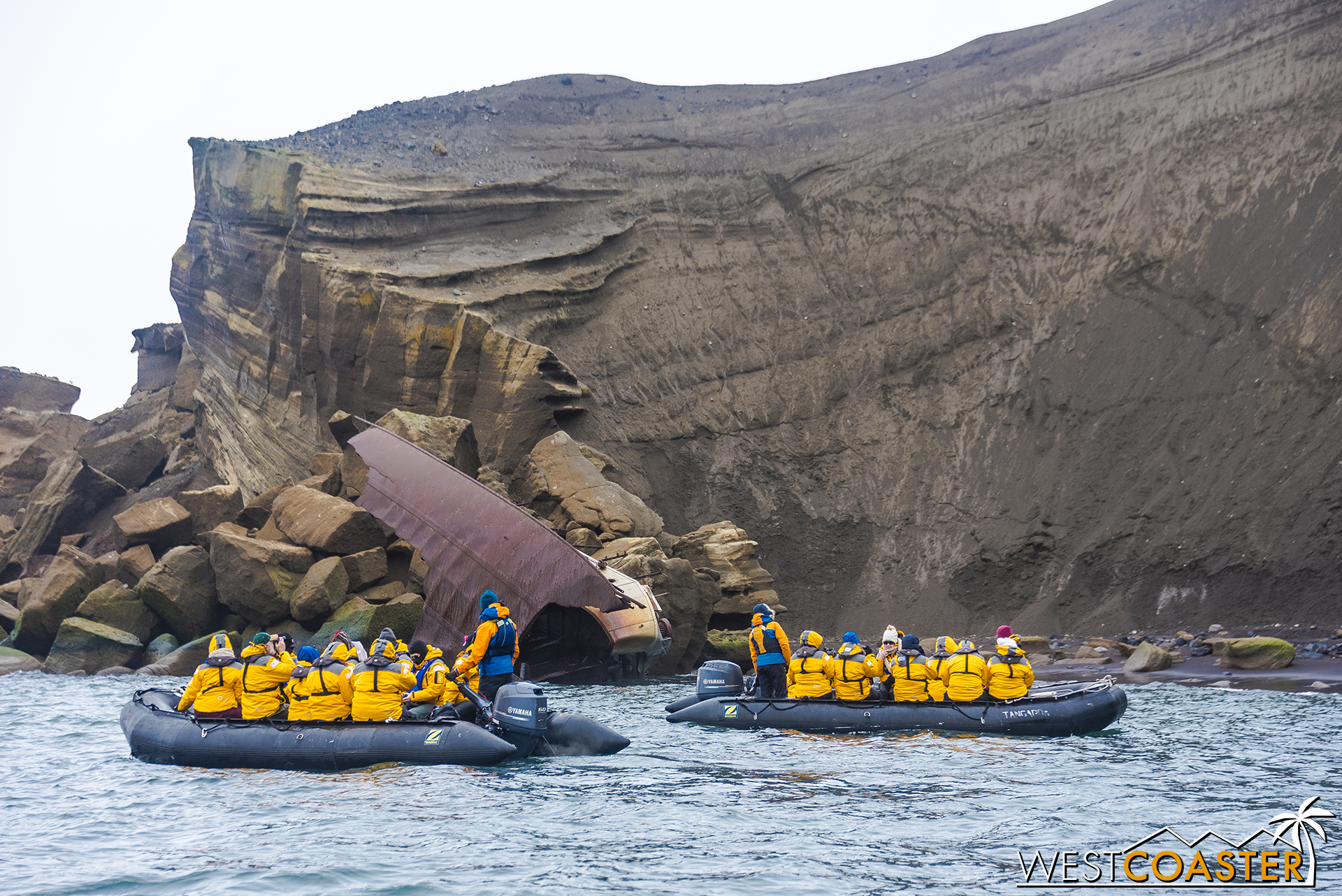 Two Zodiacs' worth of explorers check out the wreckage of an old ship.