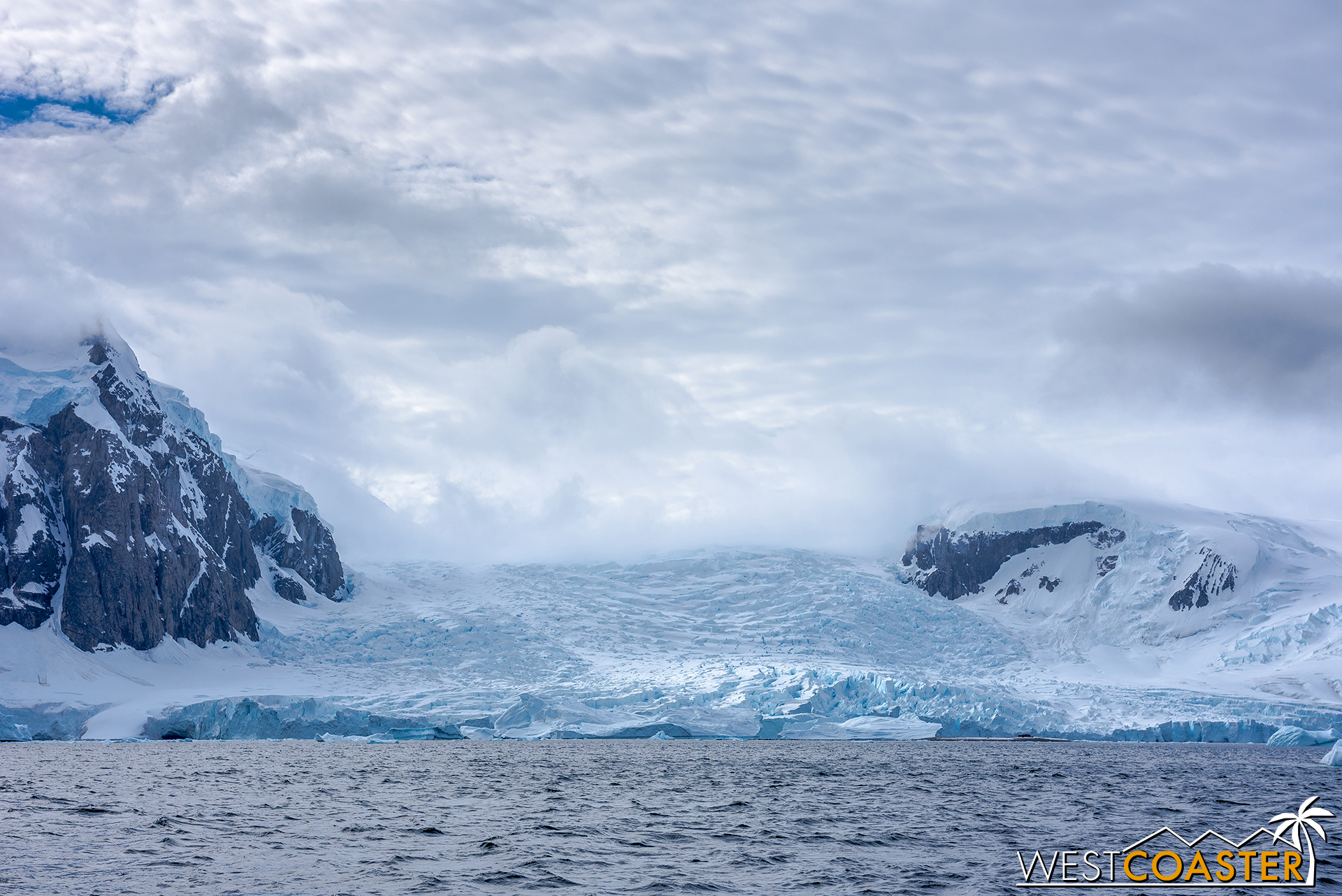 A glacier folds its ice into the water.
