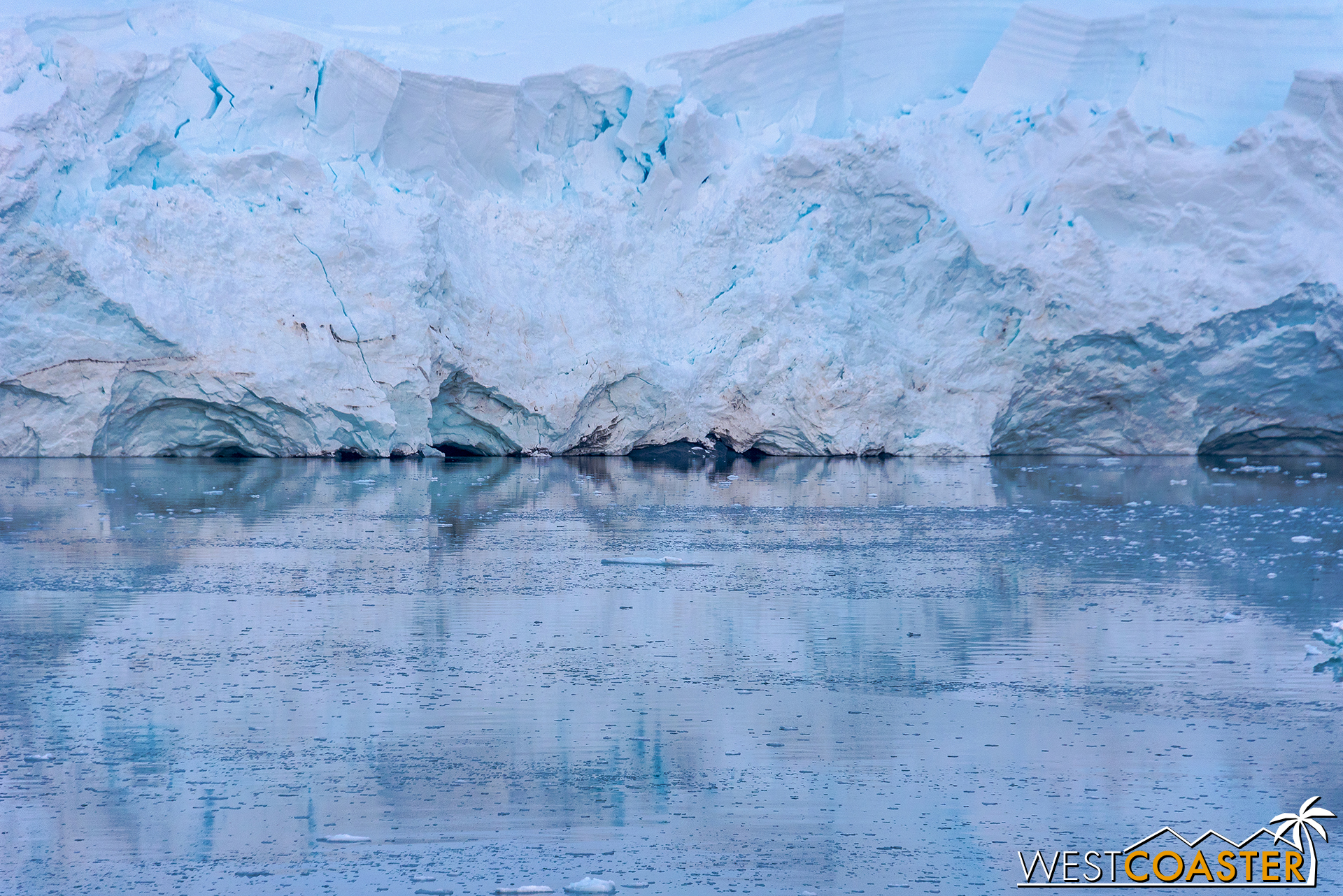 Reflections at the edge of the ice and water.
