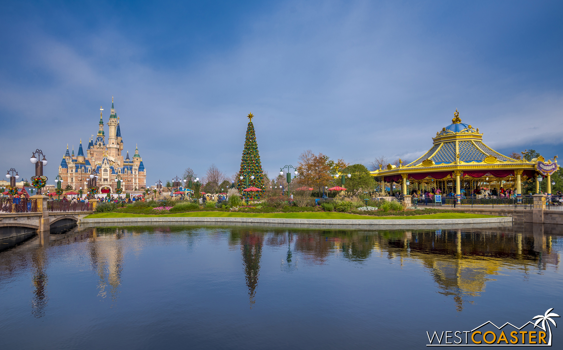 Left to right, the Enchanted Storybook Castle, a towering Christmas tree, and the Fantasia Carousel mark a skyline of sorts in the Gardens of Imagination.