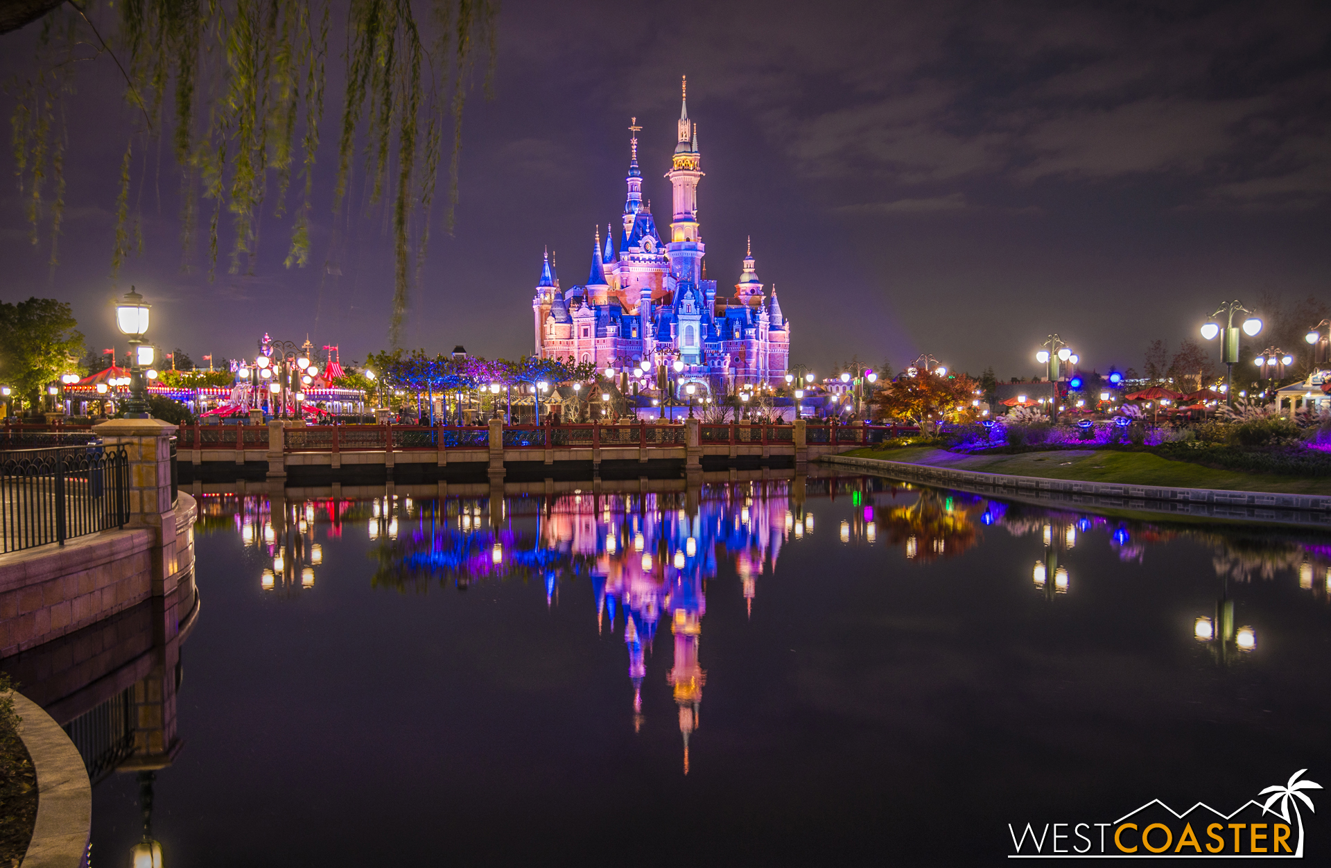 The Enchanted Storybook Castle reflects off one of many ponds throughout the Gardens.