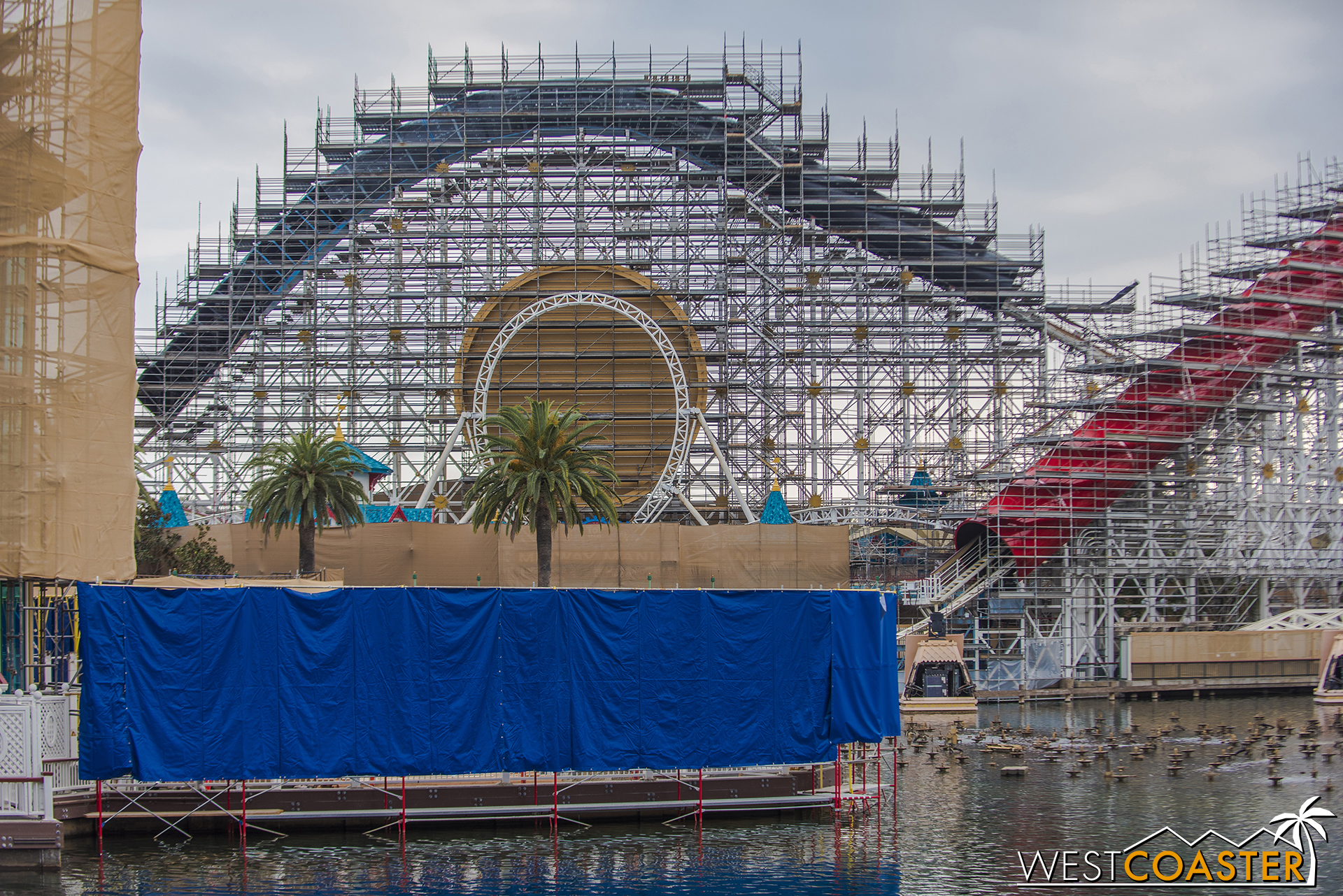 Work continues on the outdoor lower deck, though they've placed tarps to block off direct sight from all the areas that could overlook it.