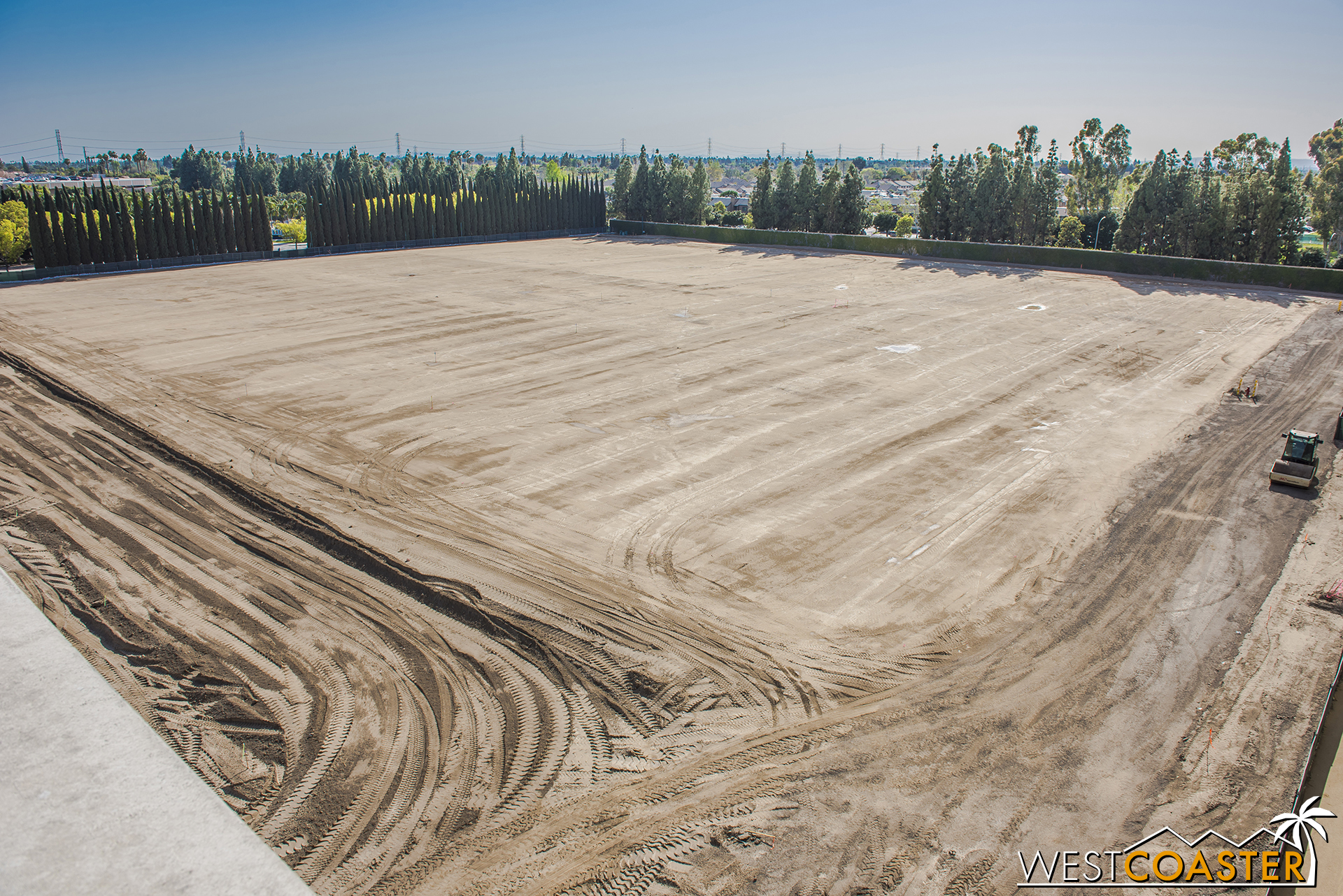 Meanwhile, the site on the west half has been graded so flatly that it almost looks like they just sprinkled dirt over the existing parking lot asphalt.