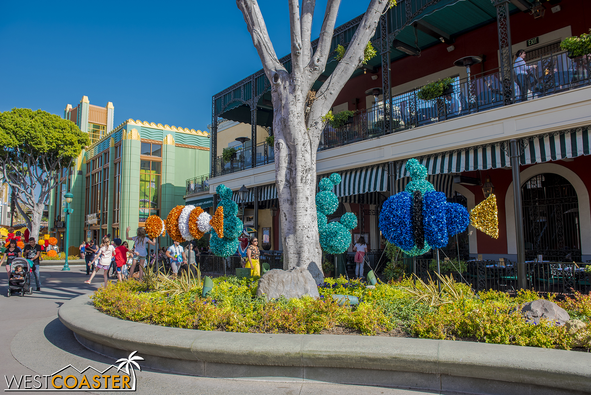 In Downtown Disney, they're accompanied by these tinsel-y Pixar figures.