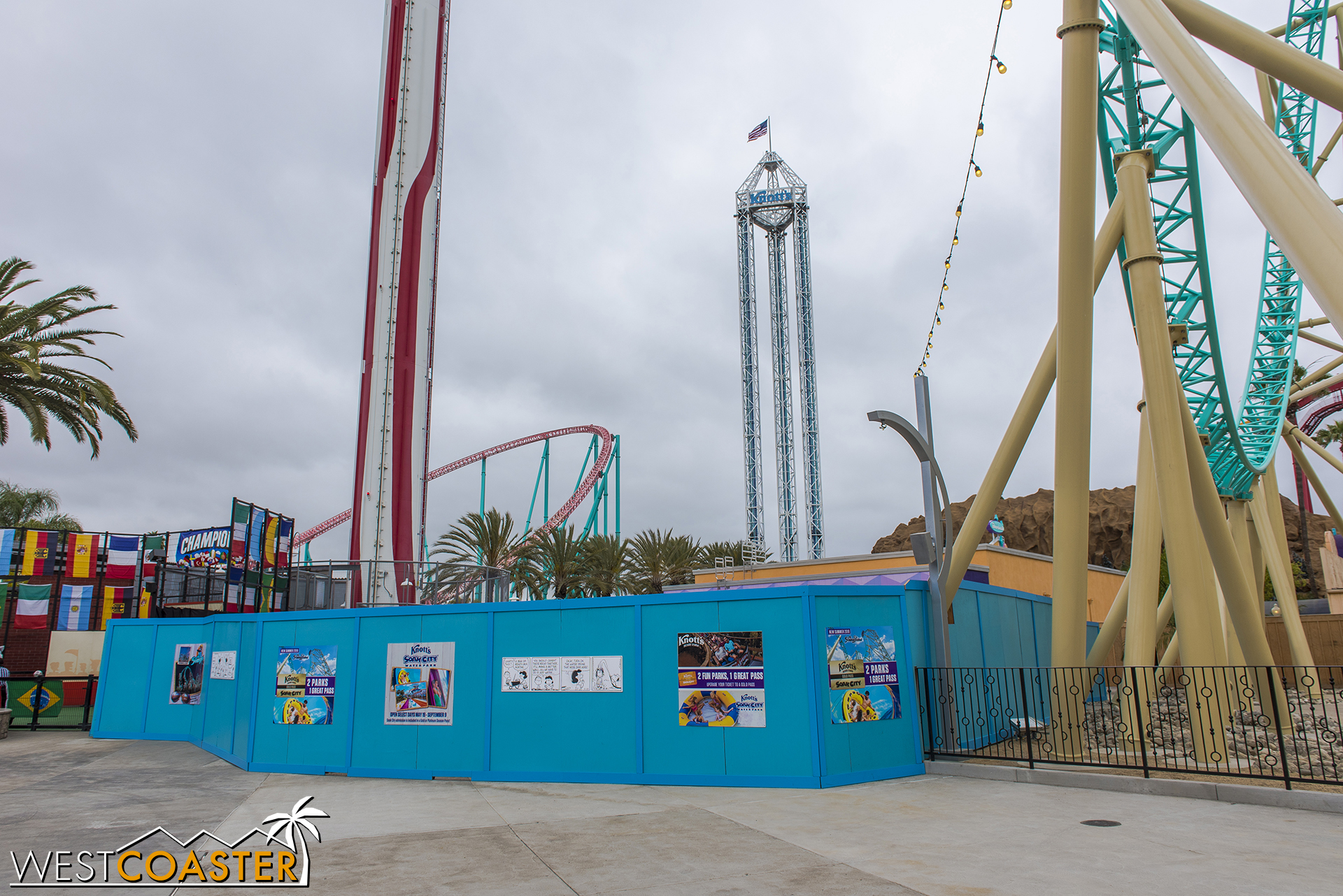 A little bit of the HangTime construction footprint remains behind work walls, as the park constructs a new footing and pad for the very slightly relocated Wipeout ride, next to the Sky Cabin.