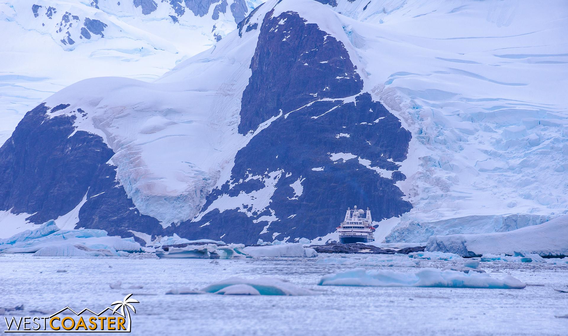 Adjacent mountains dwarf our  Ocean Diamond  cruise ship.