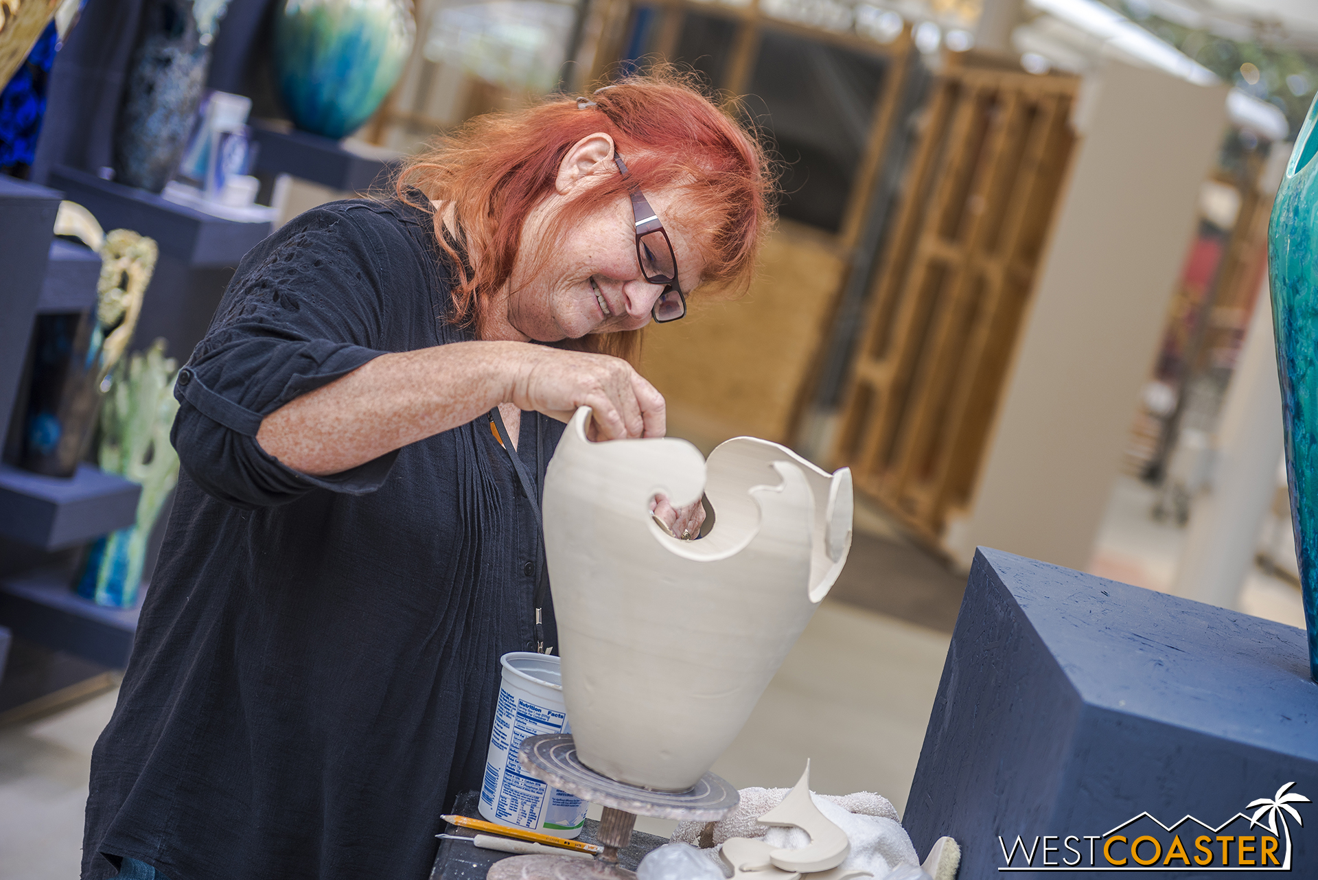 Sharon working on a vase.