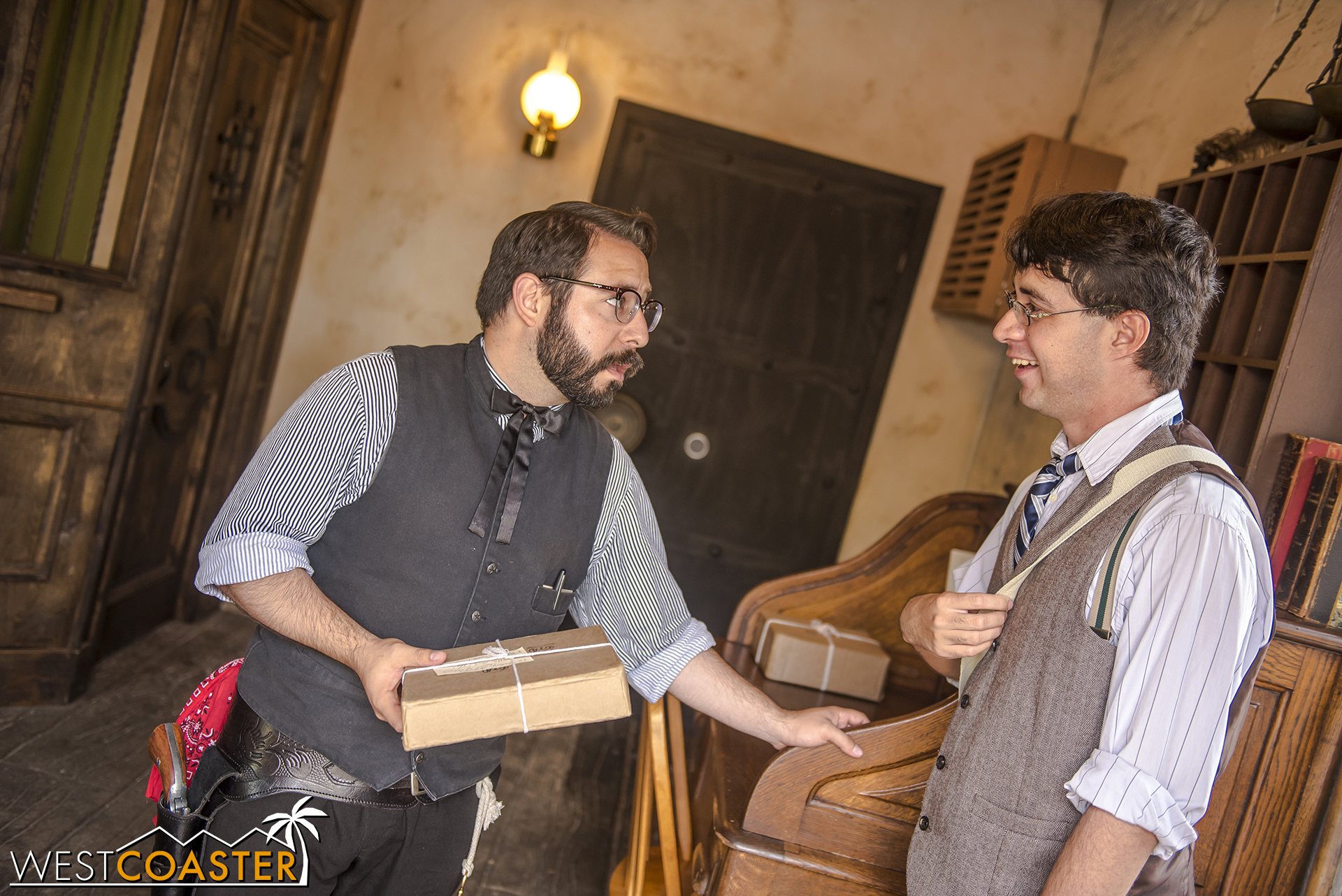Bank guard Antonio asks a guest to deliver a package to another Citizen of Calico.