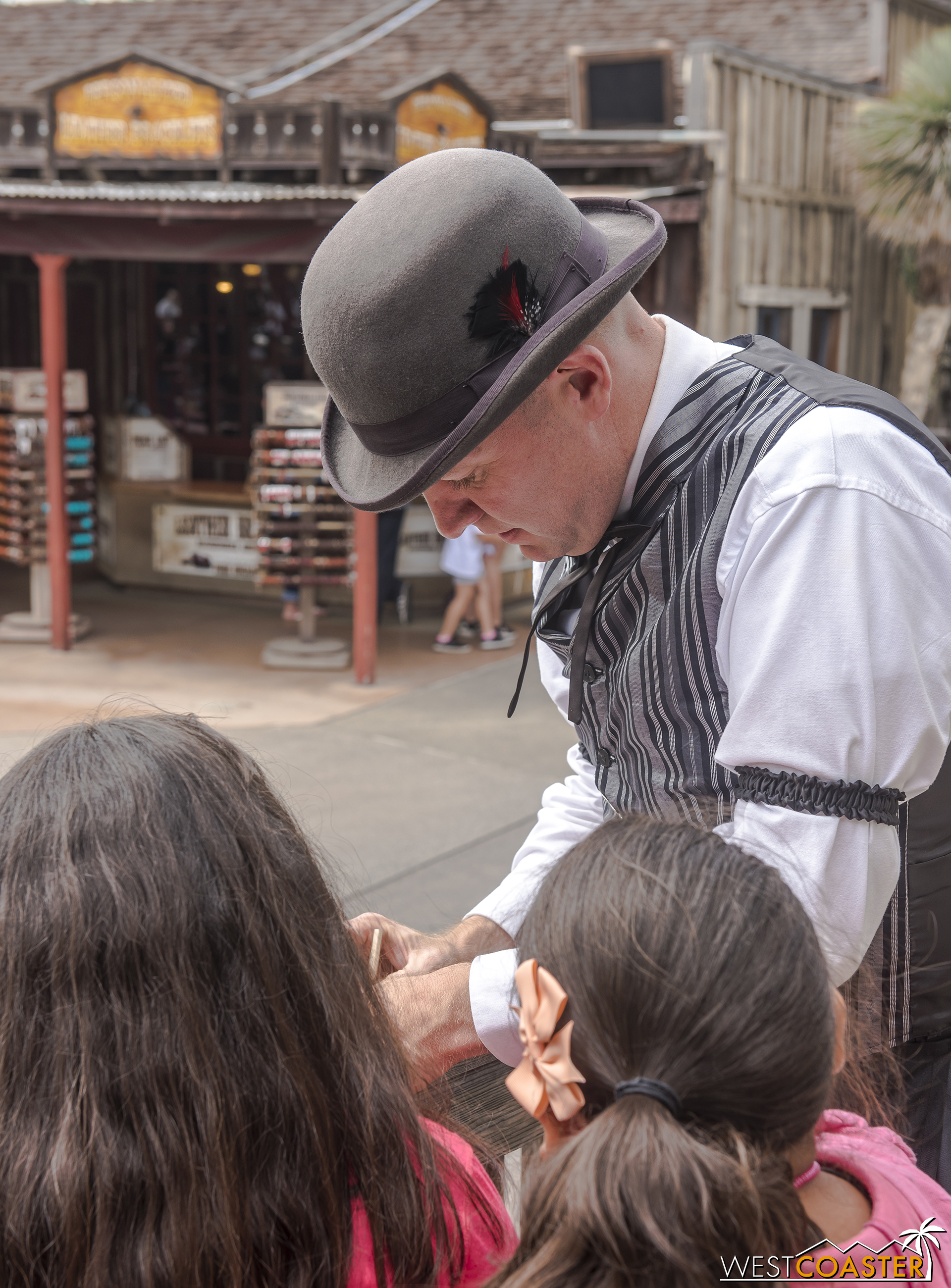Colonel Potter engages with two young guests, asking them to help with a task.