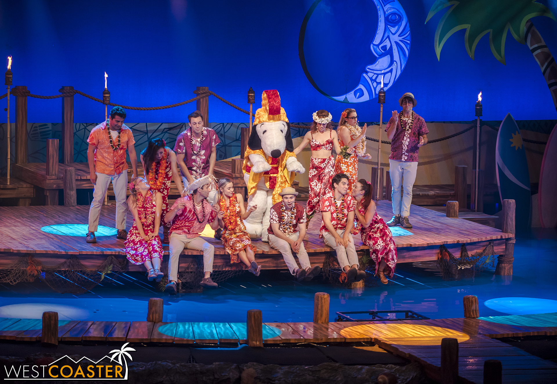 The joyous performance pleases the apparent tiki gods who've been watching, and the group is rewarded with treasure spilling out of the tiki statues on either side of the stage.