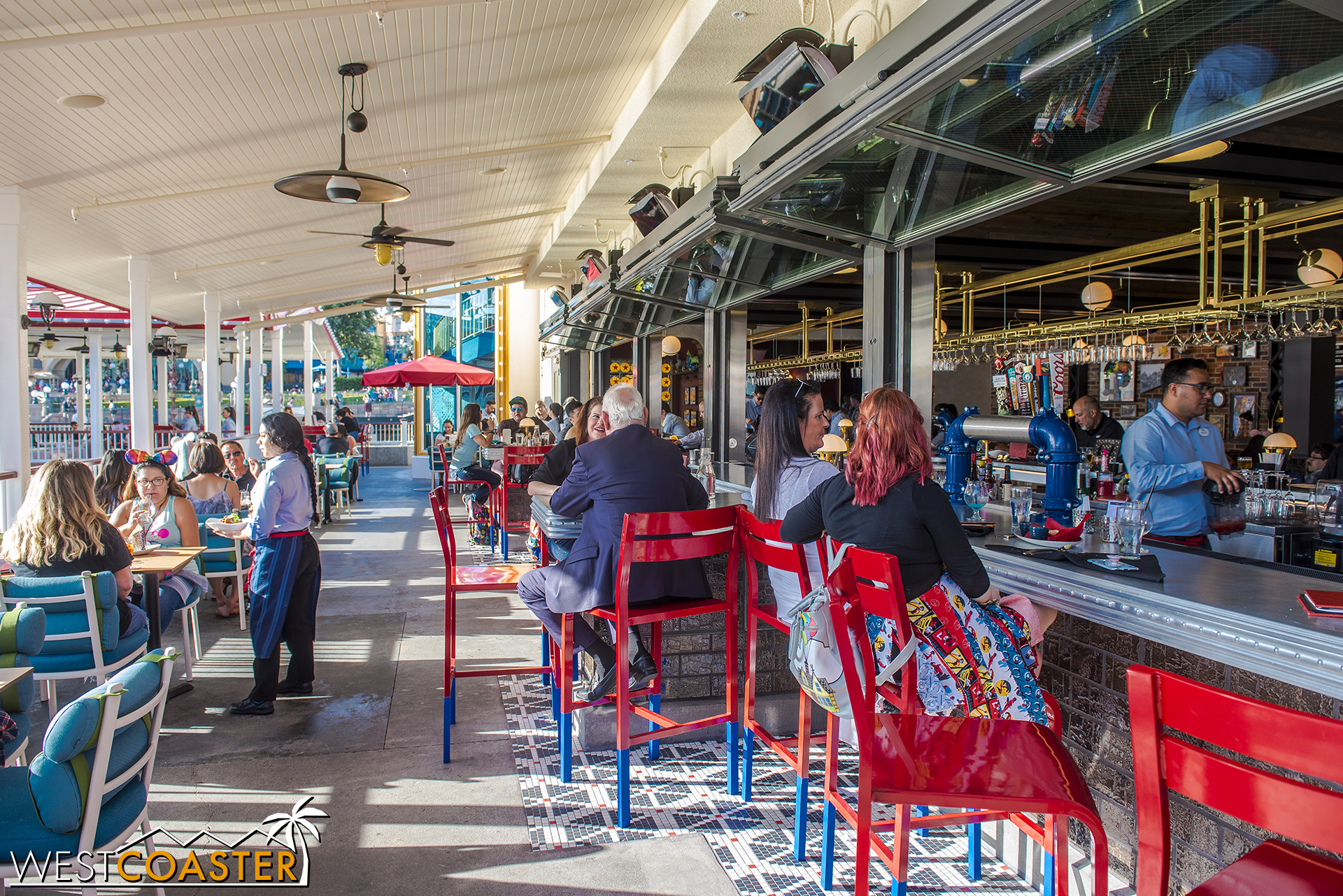 On the outside, these bifolding counter windows open up the bar to serve exterior patrons.