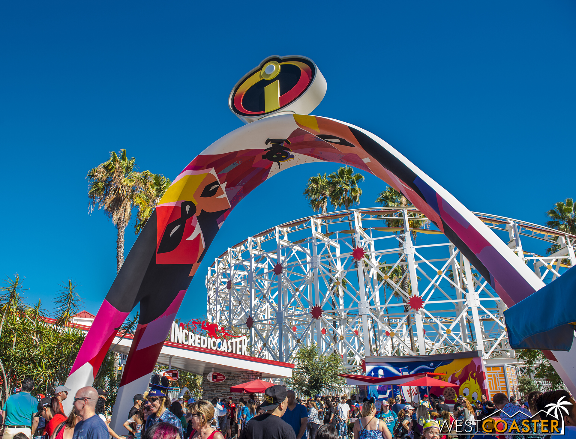 A sleek archway marks the entrance into the entry plaza for the Incredicoaster.