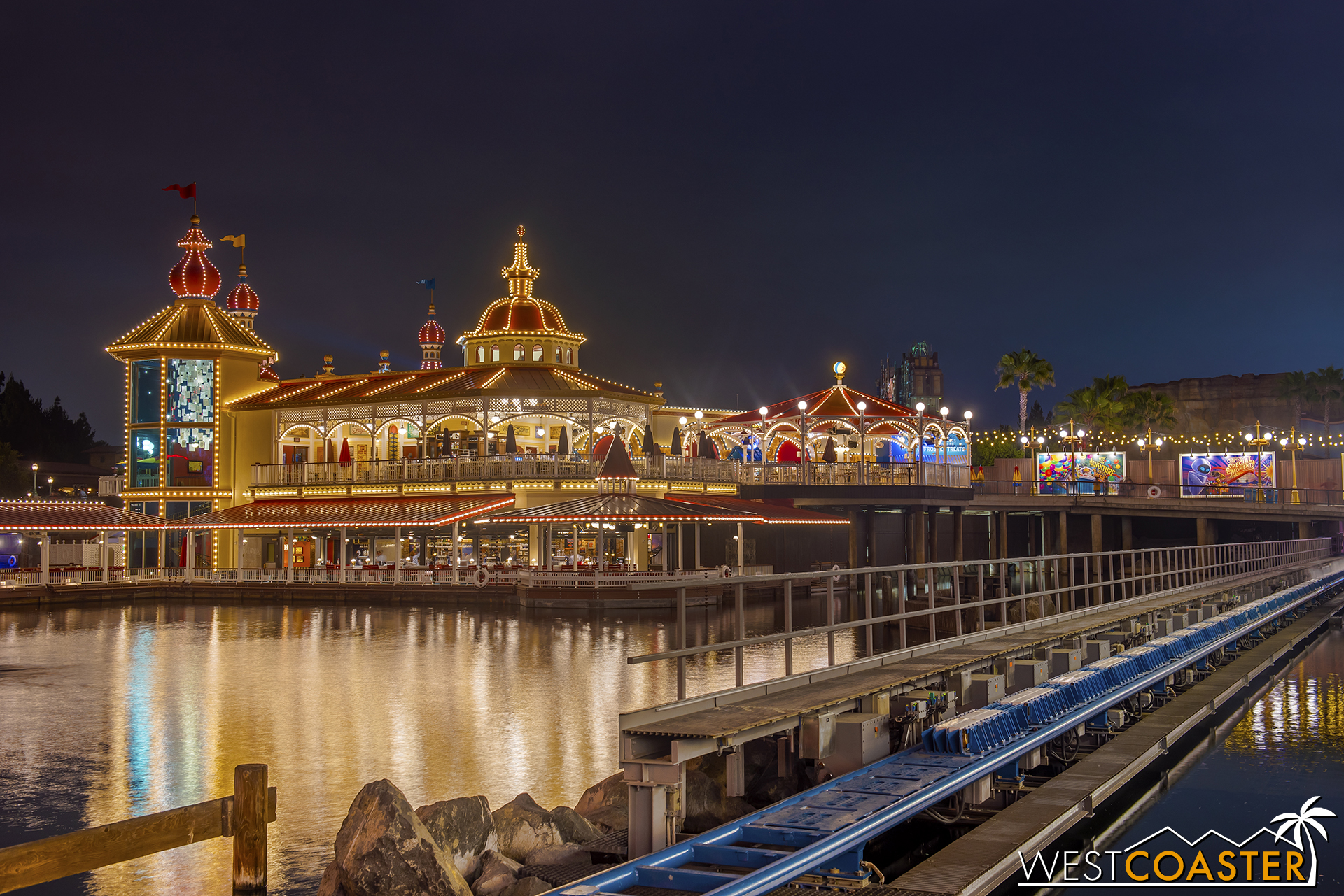 At night, the water effect is light up in red as the roller coaster train launches.